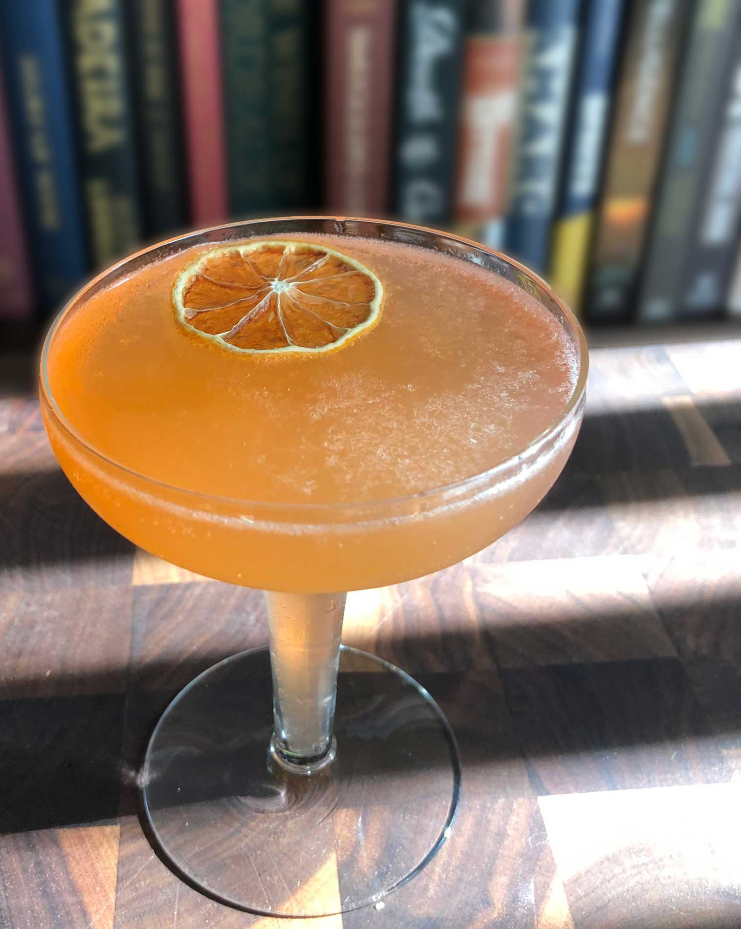 An example of the Front Porch Fizz, the mixed drink (fizz), adapted from a drink by Kellie Thorn, Empire State South, Atlanta, Georgia, featuring sparkling wine, Hayman's London Dry Gin, Aperitivo Cappelletti, watermelon syrup, and lemon juice; photo by Lee Edwards