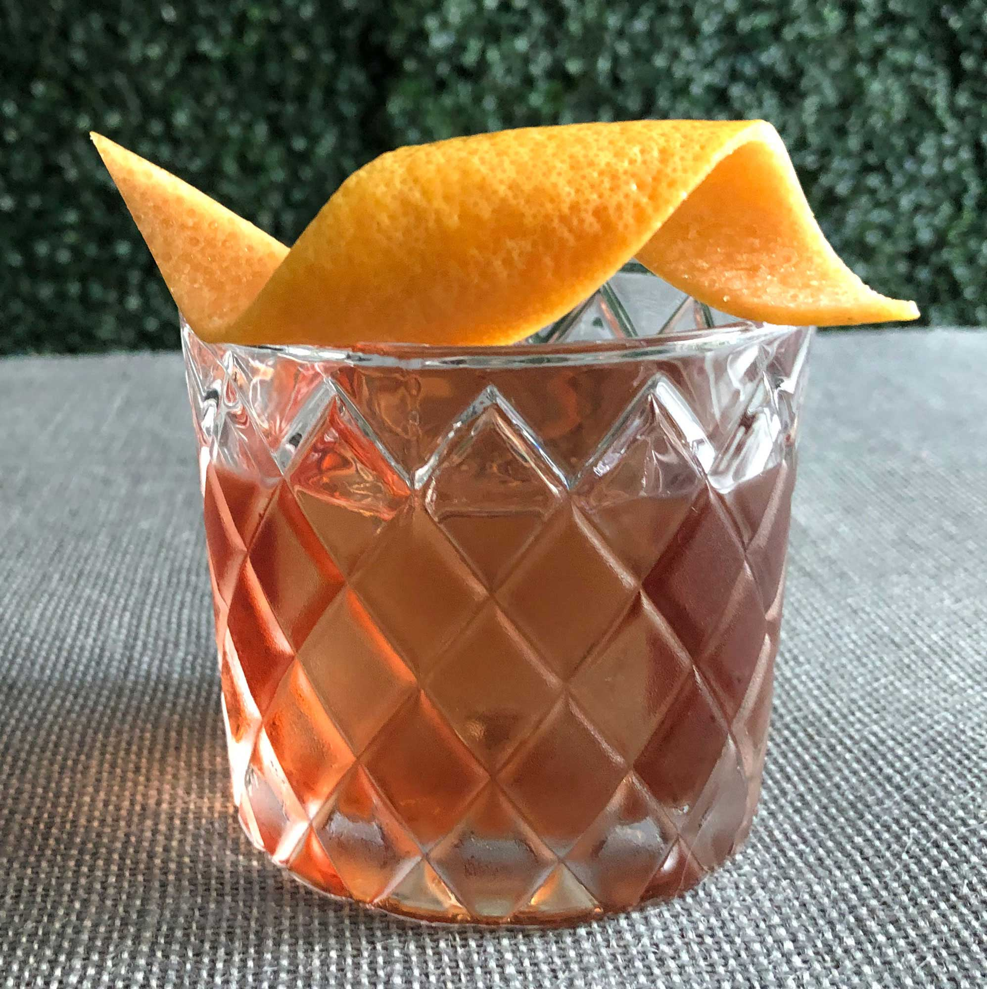 An example of the Count of Mount Kisco, the mixed drink (cocktail), by Scott Krahn, New York City, featuring Averell Damson Plum Gin Liqueur, Dolin Dry Vermouth de Chambéry, and Salers Gentian Apéritif; photo by Lee Edwards