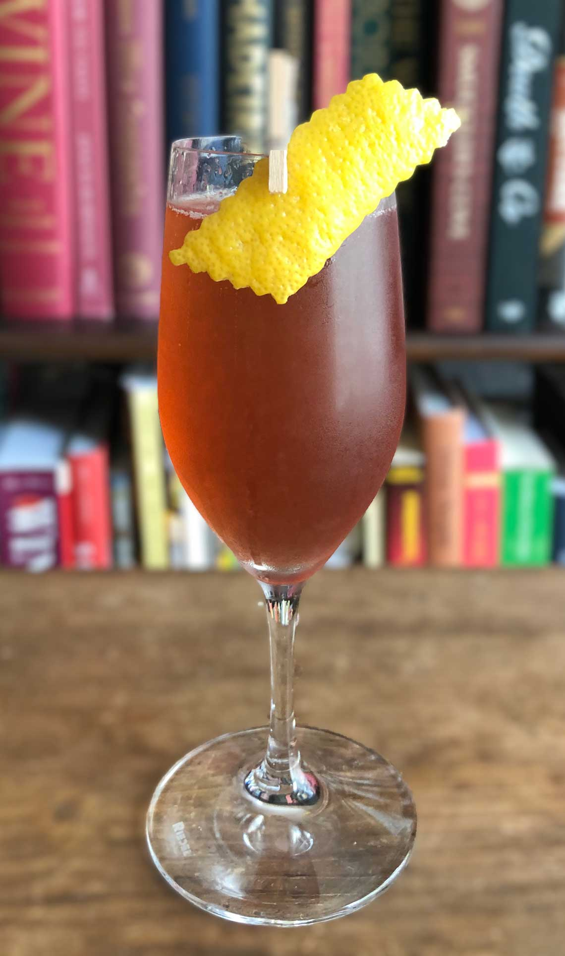 An example of the Damson Royale, the mixed drink (cocktail) featuring sparkling wine, Averell Damson Plum Gin Liqueur, and lemon juice; photo by Lee Edwards