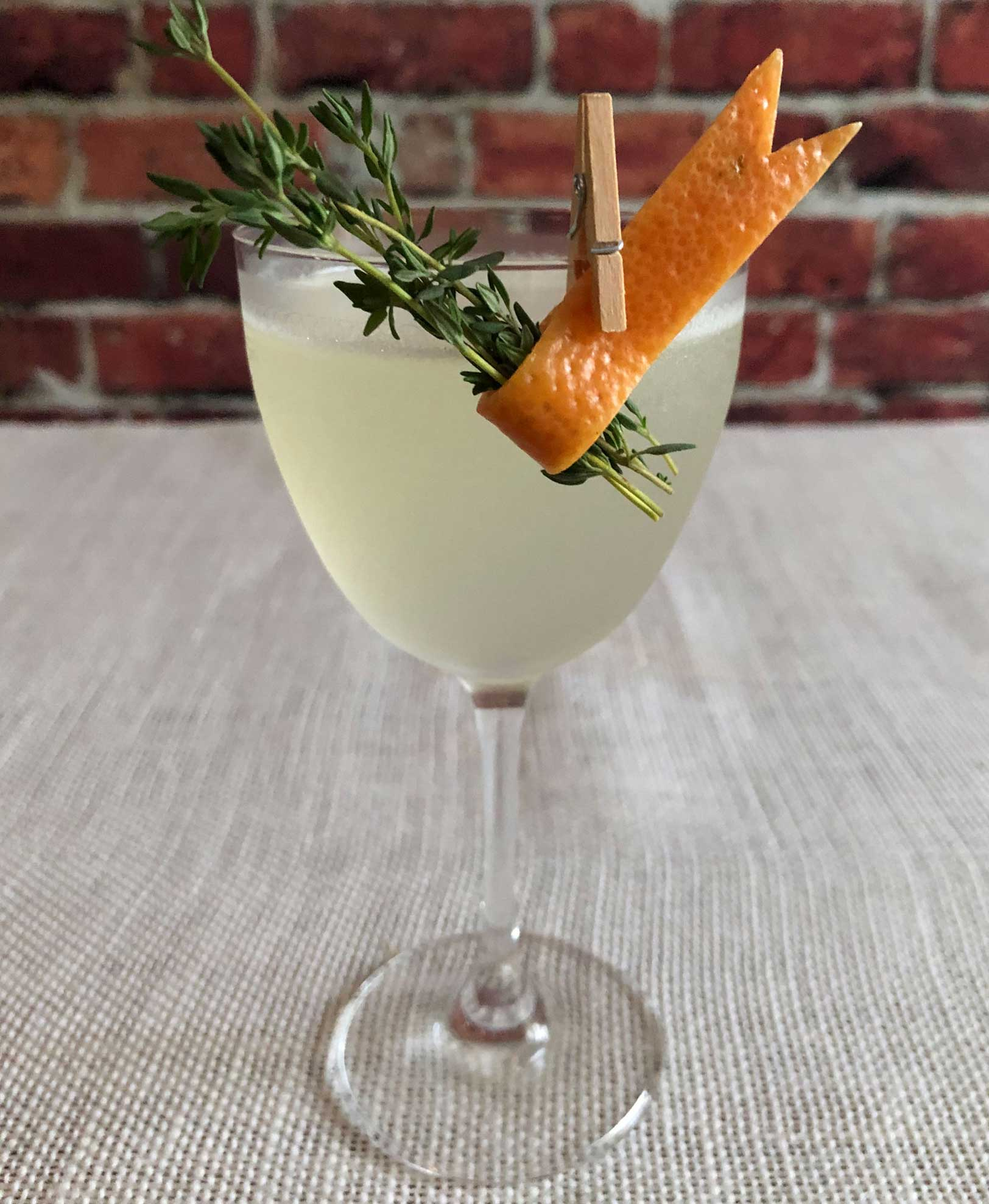 An example of the Hemingway in Europe, the mixed drink (cocktail), by Patrick Williams, Punch Bowl Social, Denver, featuring Batavia Arrack van Oosten, grapefruit oleo-saccharum, lime juice, and maraschino liqueur; photo by Lee Edwards