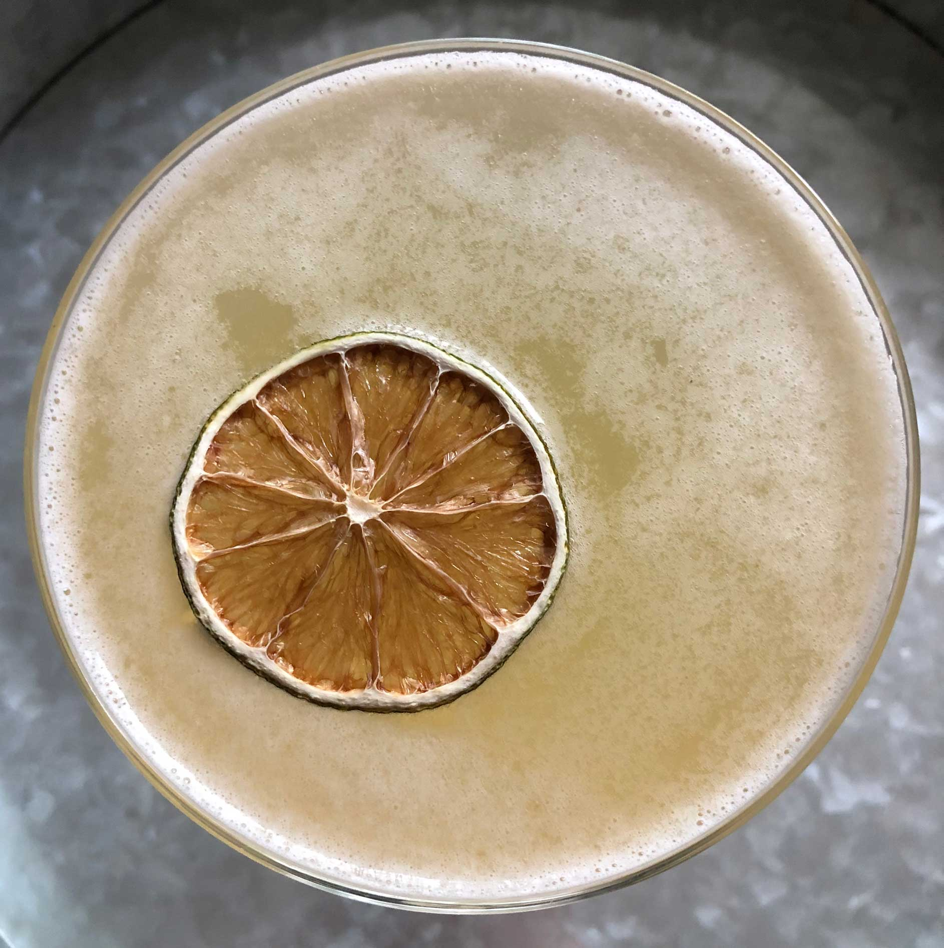 An example of the Airmail, the mixed drink (cocktail) featuring sparkling wine, Batavia Arrack van Oosten, lime juice, and raw sugar syrup; photo by Lee Edwards