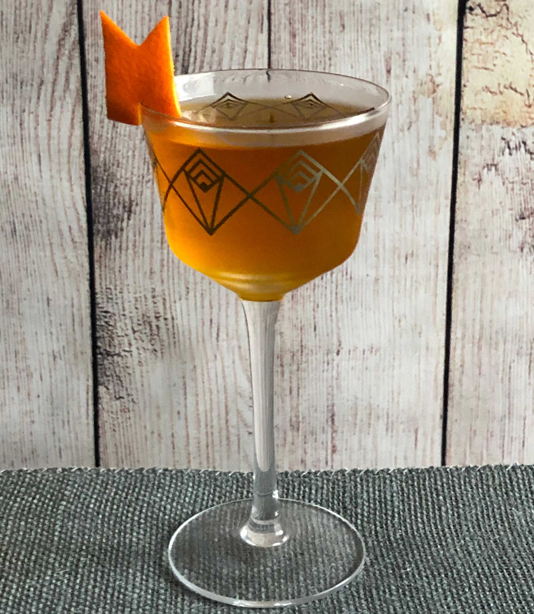An example of the Accidental Cocktail, the mixed drink (cocktail), adapted from the Occidental, PDT, New York City, featuring Batavia Arrack van Oosten, orange-flavored liqueur, Cardamaro Vino Amaro, and Elisir Novasalus; photo by Lee Edwards