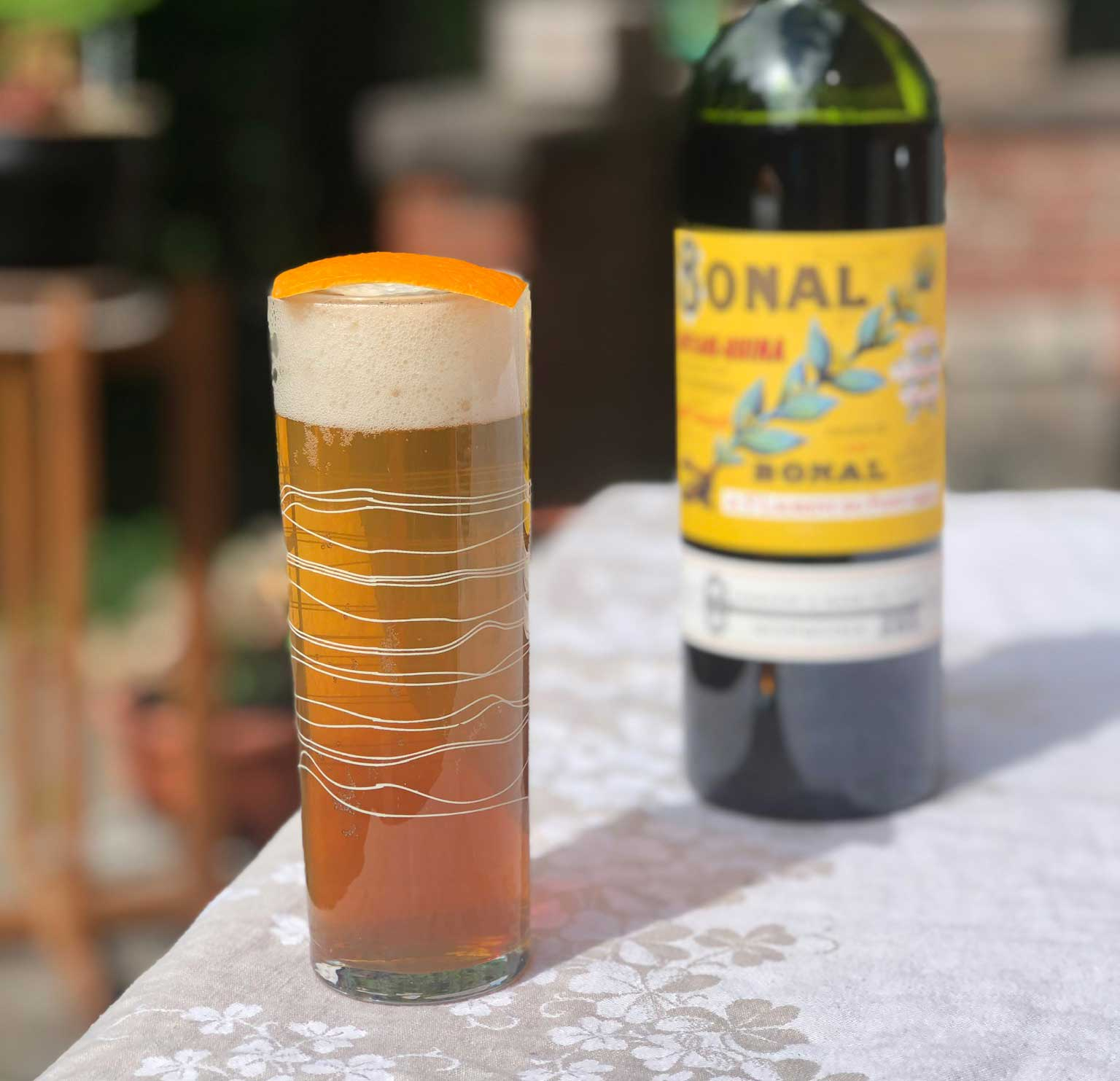 An example of the Amer Frontière, the mixed drink (cocktail) featuring lager, Bonal Gentiane-Quina, and orange bitters