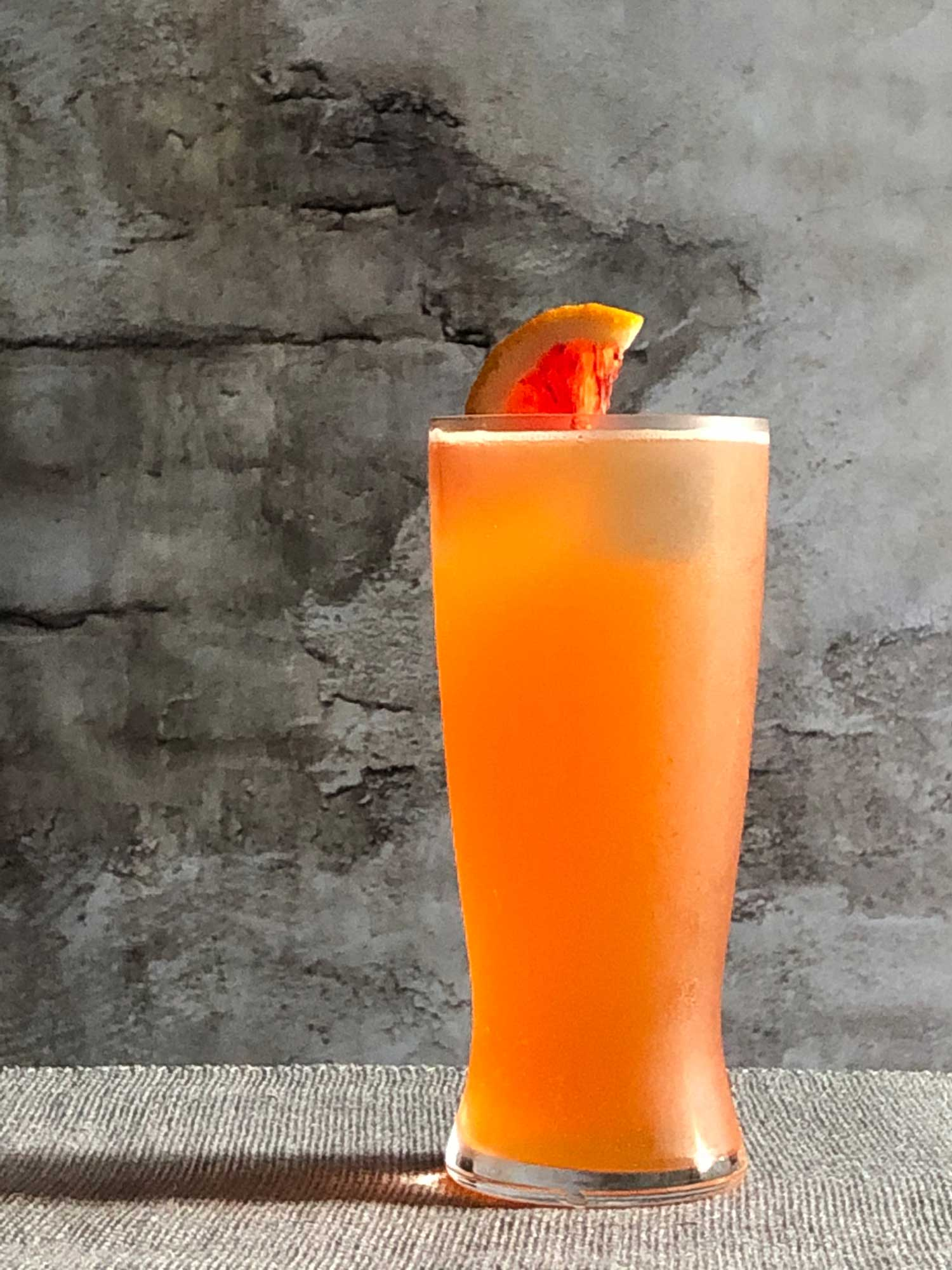 An example of the The Roadie, the mixed drink (cocktail), by Booth Hardy, Barrel Thief Wine Shop & Café, Richmond, VA. In honor of the 2015 World Road Cycling Championships, featuring Stiegl Grapefruit Radler, and Aperitivo Cappelletti; photo by Lee Edwards