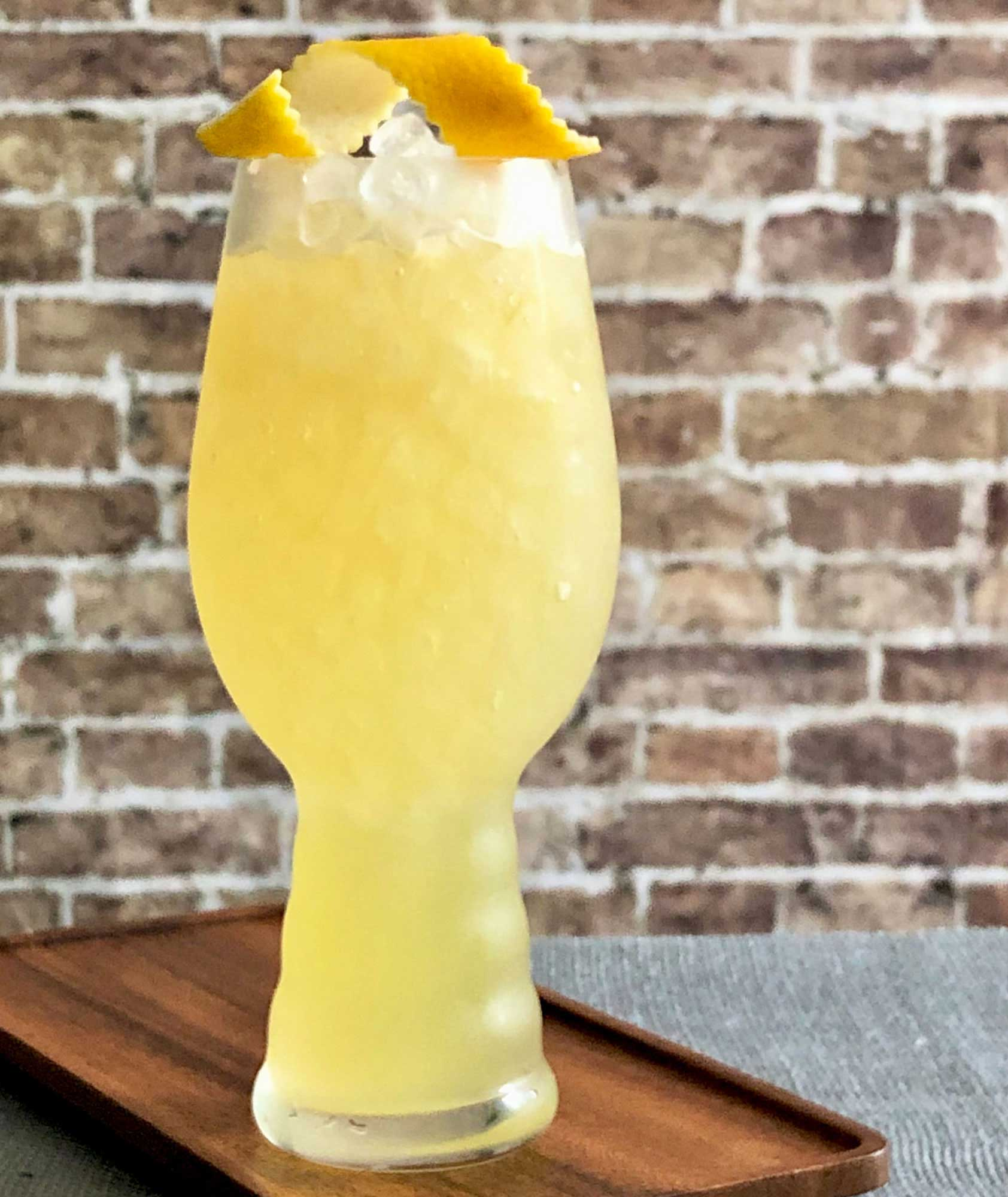 An example of the Strange Brew, the mixed drink (cocktail), adapted from a drink from Death & Co., New York City, featuring india pale ale, Hayman's London Dry Gin, pineapple juice, John D. Taylor's Velvet Falernum, and lemon juice; photo by Lee Edwards