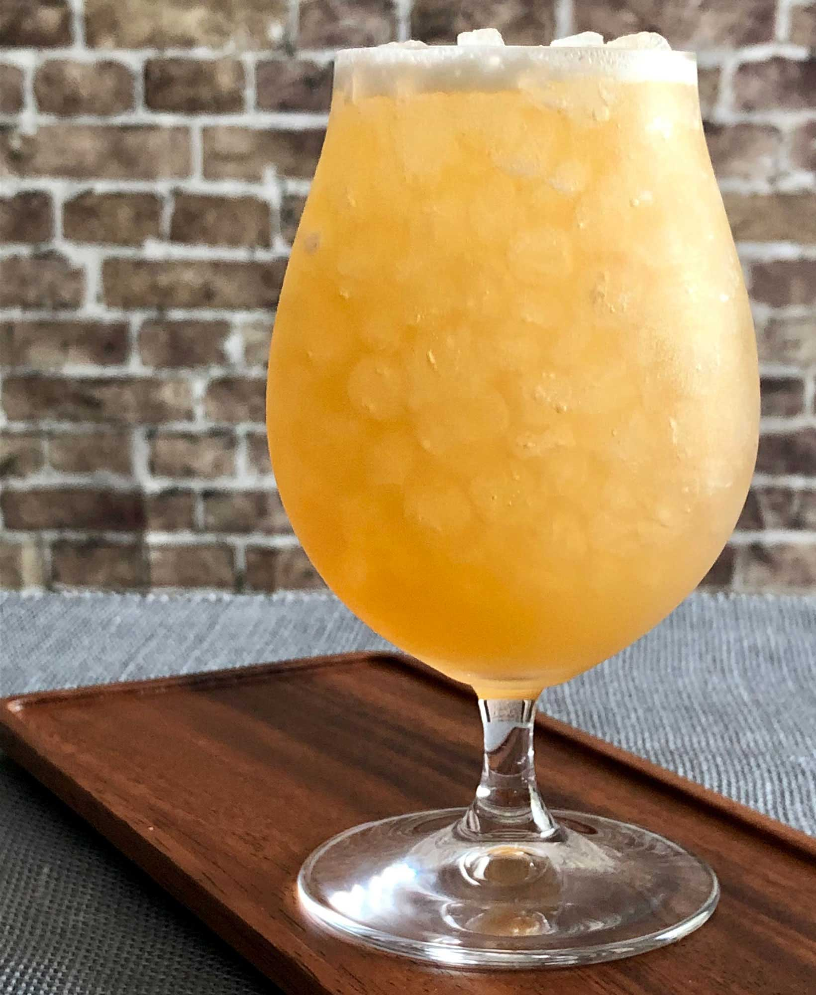 An example of the Sawbuck, the mixed drink (cocktail), by Kirkland Tap & Trotter, Cambridge, MA, featuring india pale ale, rye whiskey, cinnamon-infused sugar syrup, lemon juice, and Nux Alpina Walnut Liqueur; photo by Lee Edwards