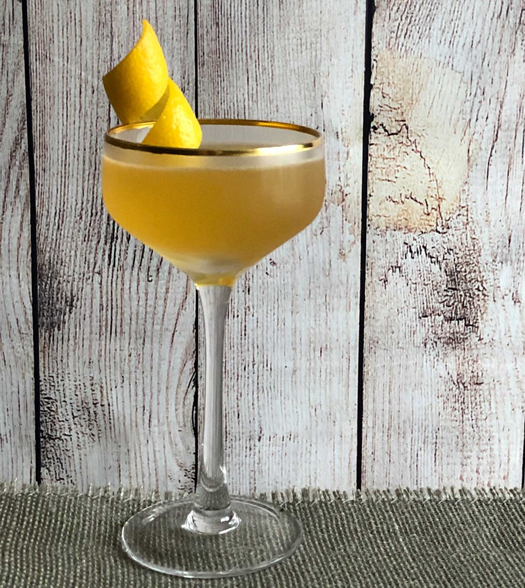 An example of the Havana Cocktail, the mixed drink (cocktail) featuring Blume Marillen Apricot Eau-de-Vie, Kronan Swedish Punsch, Hayman's Royal Dock Navy Strength Gin, lemon juice, and simple syrup; photo by Lee Edwards