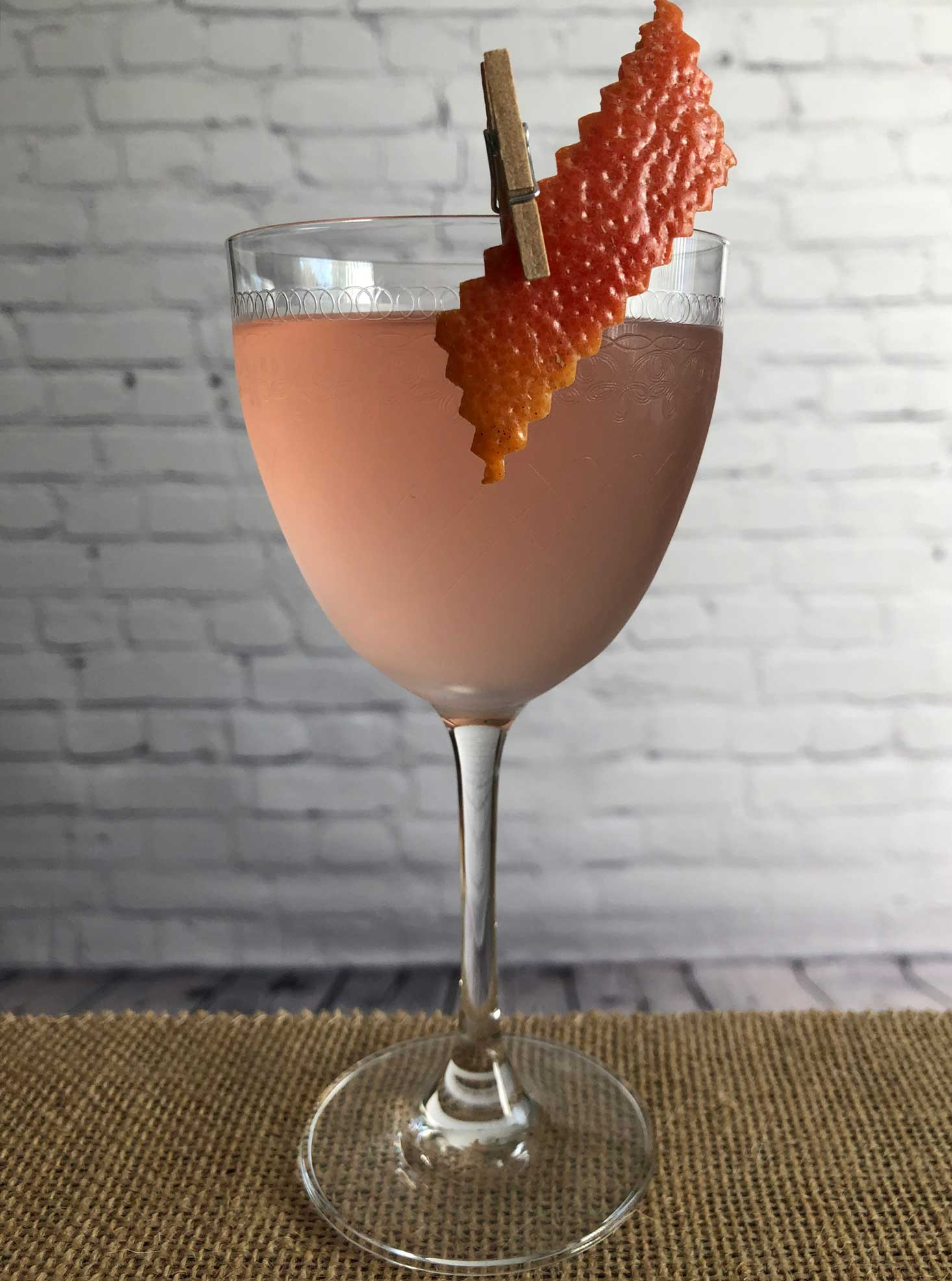 An example of the Alpen Rose, the mixed drink (cocktail), by Lee Edwards, featuring Dolin Dry Vermouth de Chambéry, Blume Marillen Apricot Eau-de-Vie, Cocchi Americano Rosa, and simple syrup; photo by Lee Edwards
