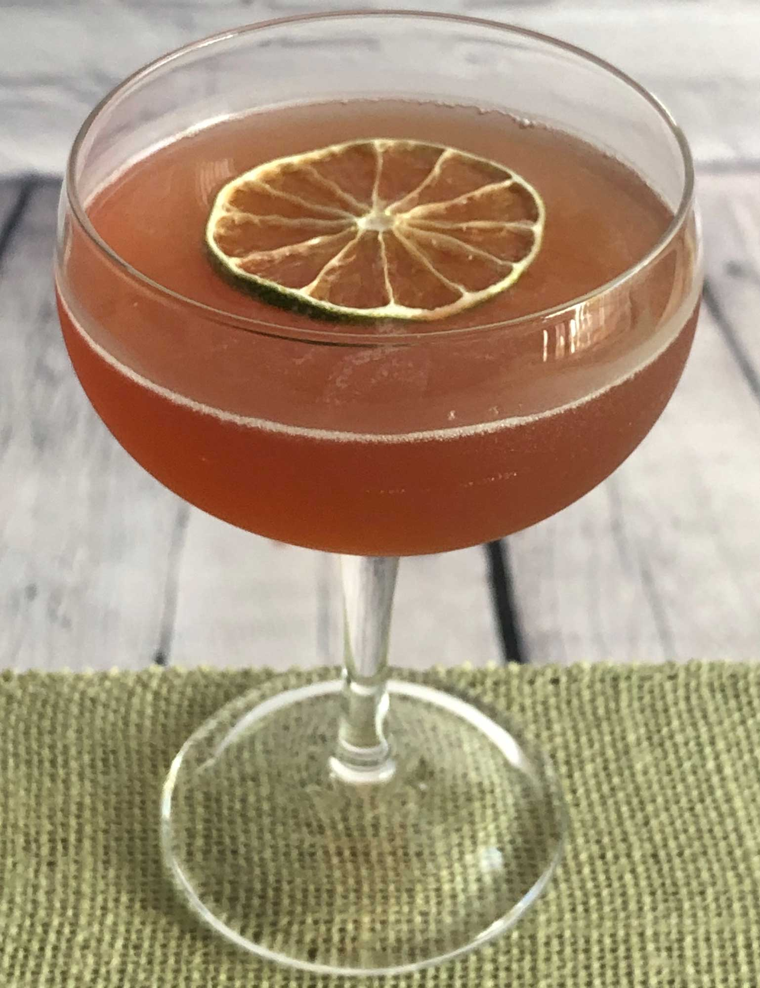 An example of the Charlie Chaplin, the mixed drink (cocktail), by Embury, The Fine Art of Mixing Drinks, featuring Blume Marillen Apricot Eau-de-Vie, Hayman's Sloe Gin, and lime juice; photo by Lee Edwards