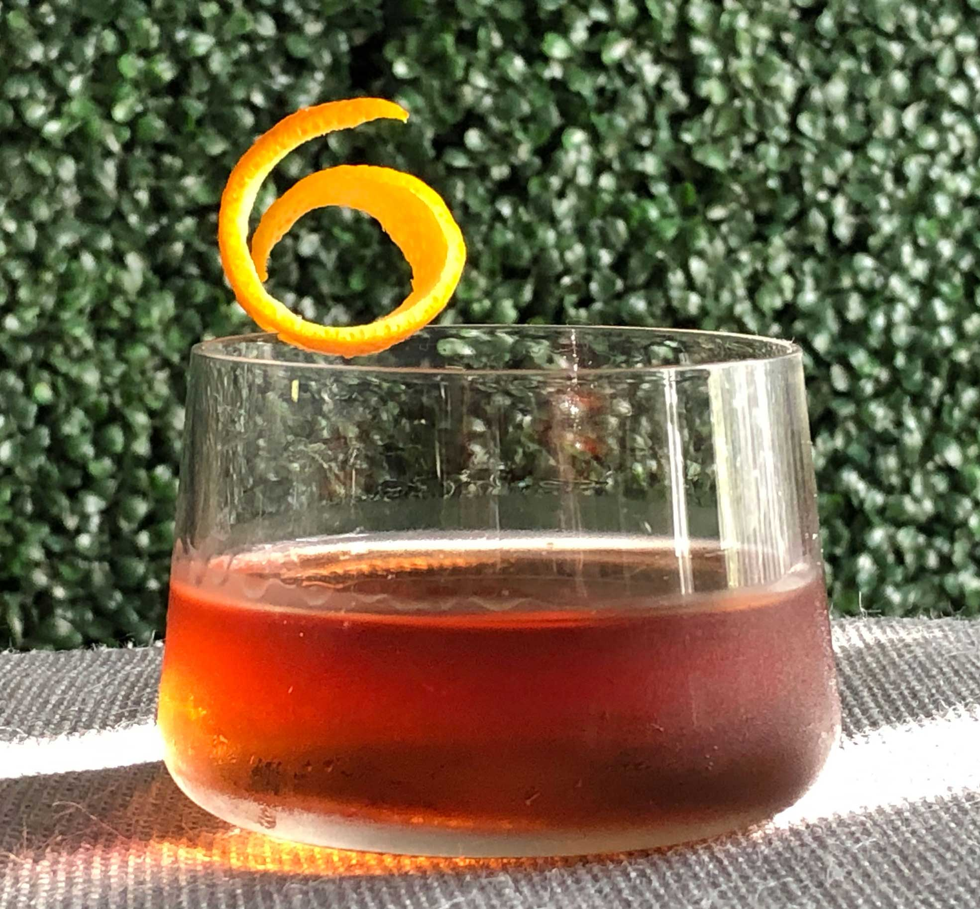 """An example of the Pat's Old Friend, the mixed drink (cocktail), adapted from the Pat's Special, Savoy Cocktail Book, featuring Bonal Gentiane-Quina, Hayman's Old Tom Gin, Mas Peyre Rancio Sec """"Le Démon de Midi"""", grenadine, and Rothman & Winter Orchard Apricot Liqueur; photo by Lee Edwards"""