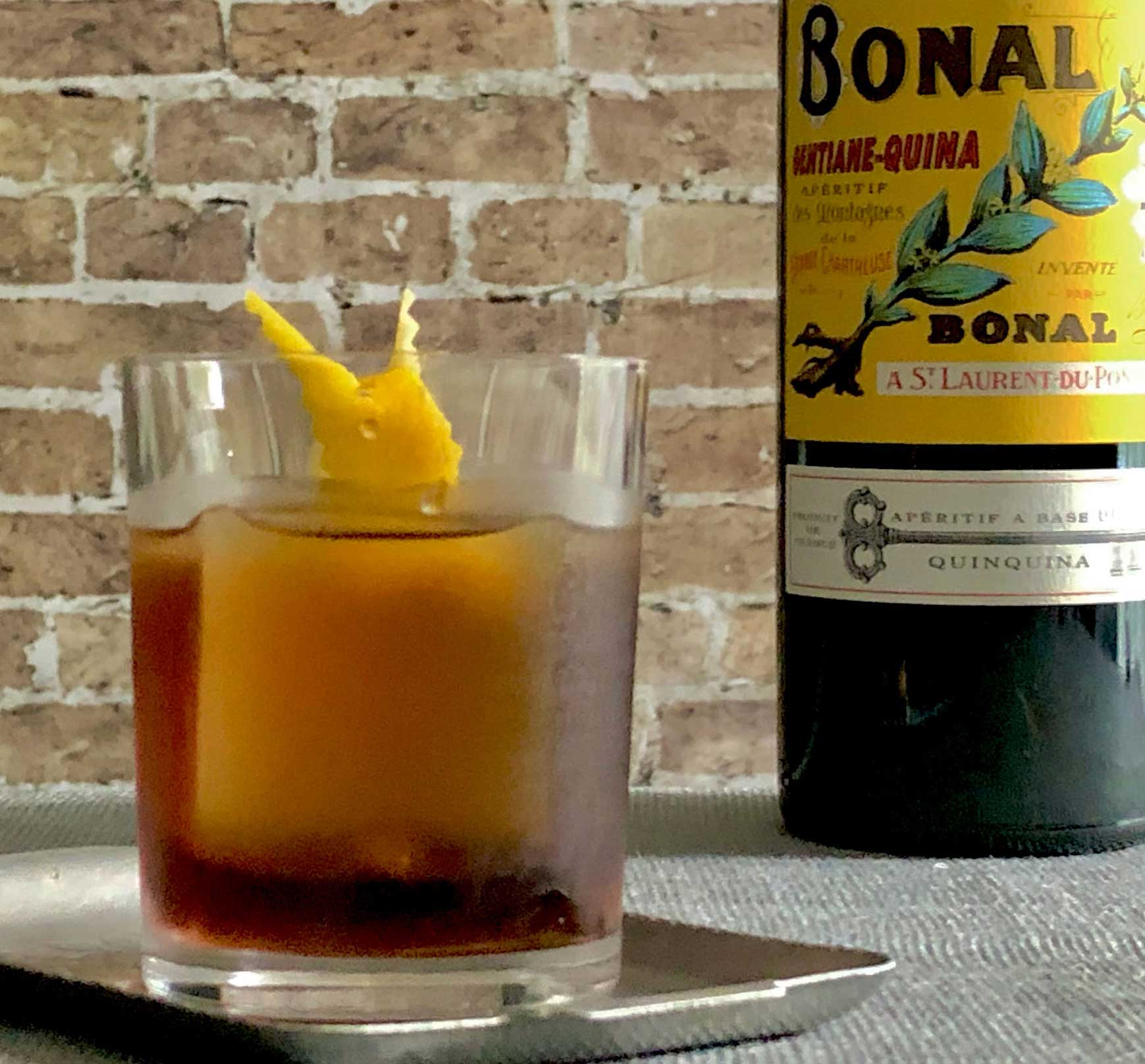 An example of the Tif & Tivo, the mixed drink (cocktail), by Rhiannon Enlil, New Orleans, featuring Bonal Gentiane-Quina, and Cocchi Americano Bianco; photo by Lee Edwards