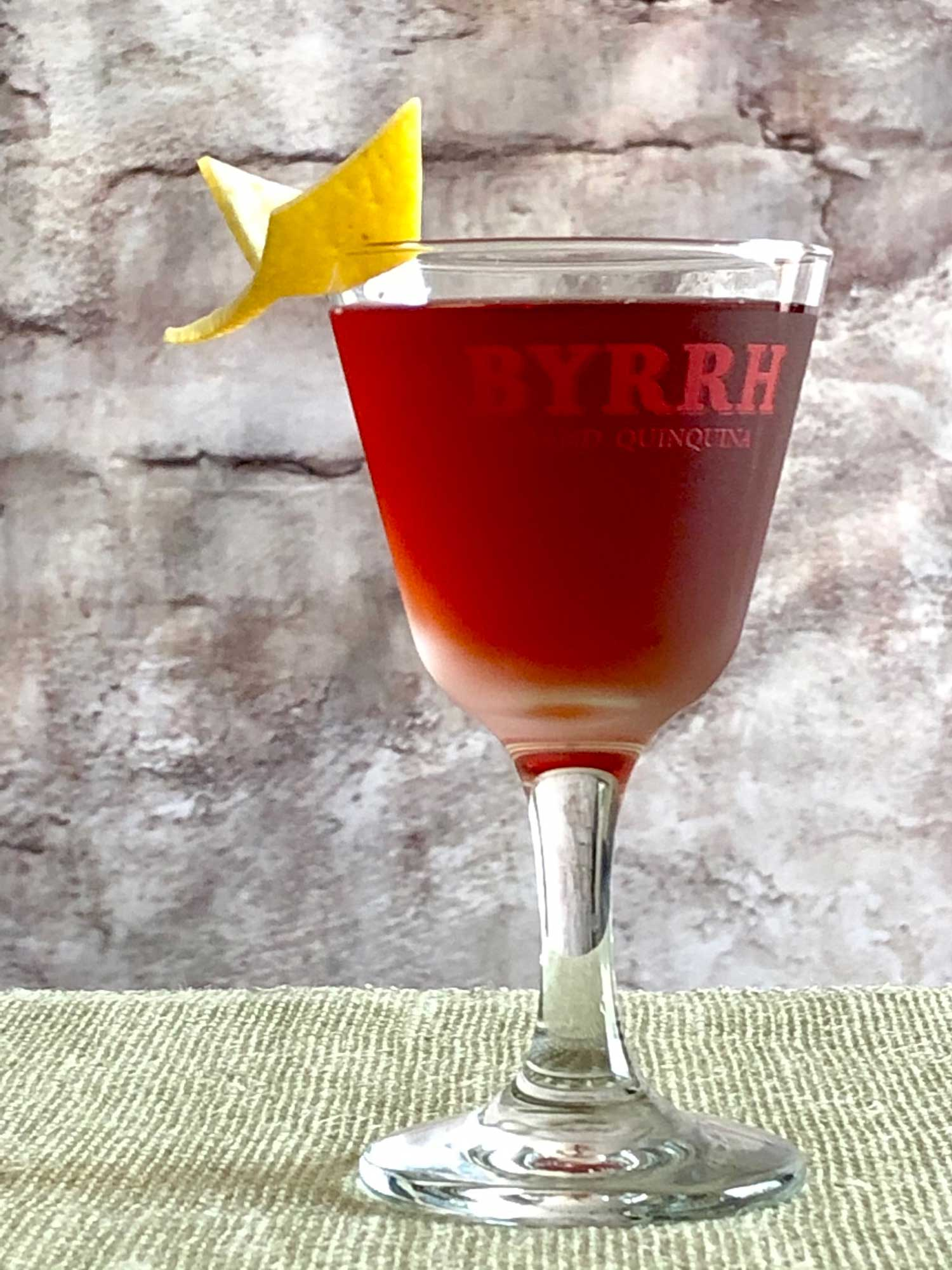 An example of the Betsy Ross, the mixed drink (cocktail), by David Embury, The Fine Art of Mixing Drinks, featuring grape brandy, Byrrh Grand Quinquina, curaçao, and Angostura bitters; photo by Lee Edwards