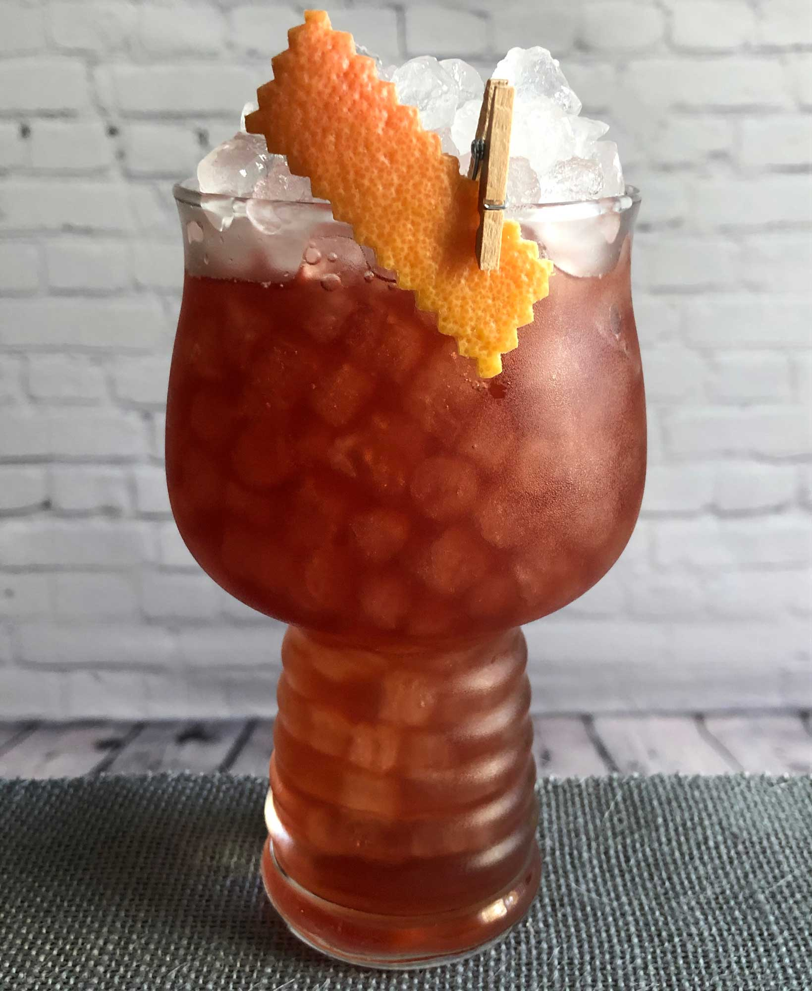 An example of the Tautavel Sunrise, the mixed drink (cocktail) featuring Byrrh Grand Quinquina, soda water, mezcal, and grapefruit juice; photo by Lee Edwards