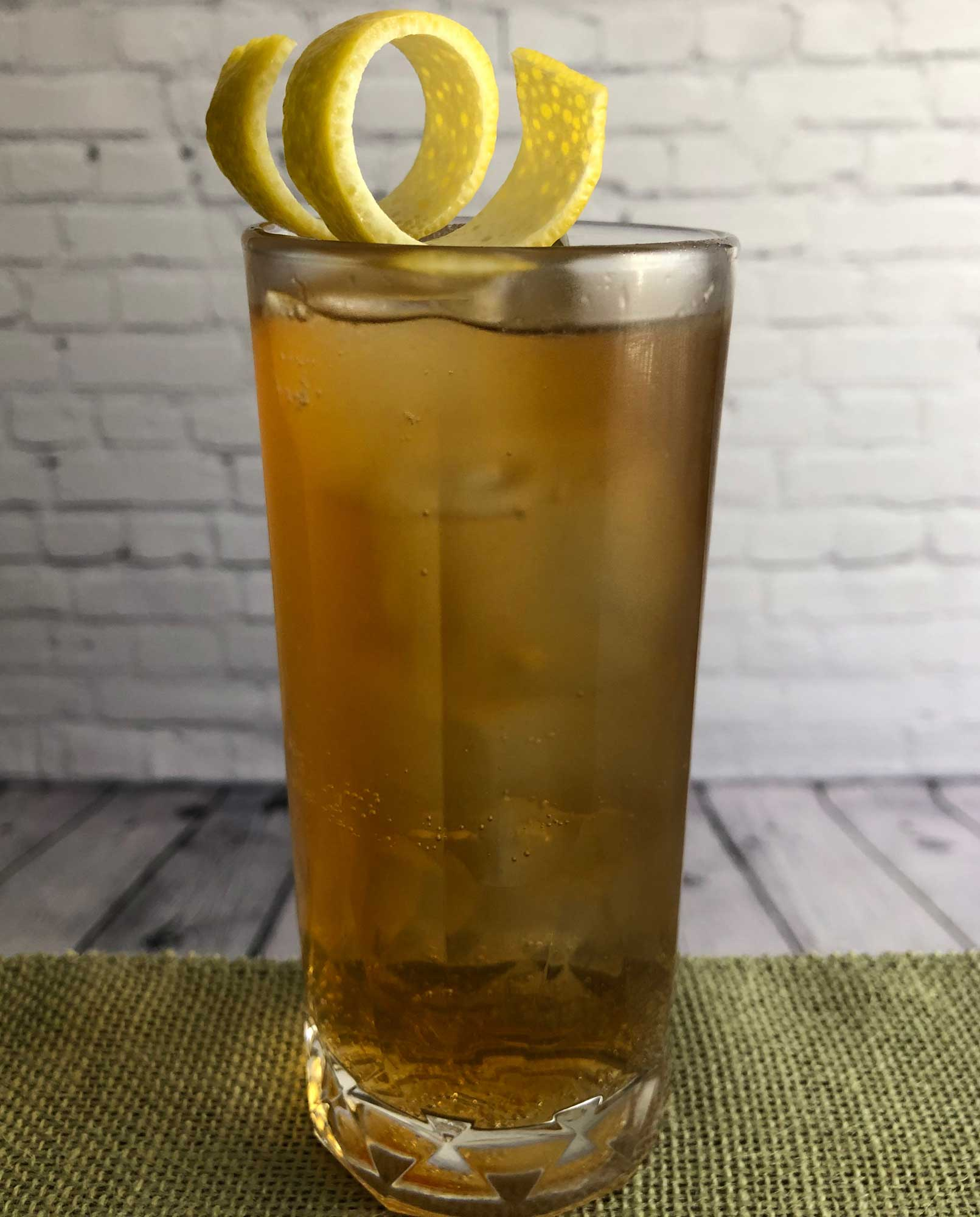 An example of the A Highball for Monte, the mixed drink (highball) featuring ginger beer, Cardamaro Vino Amaro, and lemon juice; photo by Lee Edwards
