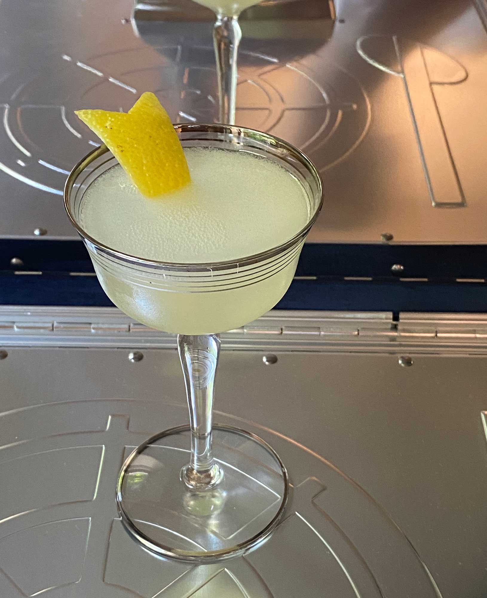 An example of the Twentieth Century, the mixed drink (cocktail) featuring Hayman's London Dry Gin, Cocchi Americano Bianco, lemon juice, and crème de cacao (white); photo by Martin Doudoroff