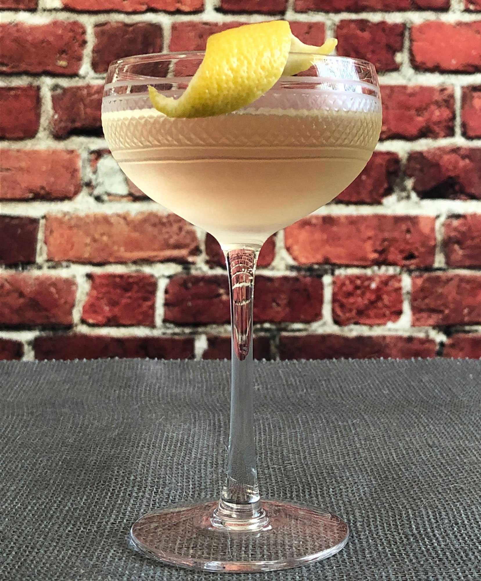 An example of the Eddie Brown, the mixed drink (cocktail), adapted from the Savoy Cocktail Book, featuring Hayman's Old Tom Gin, Cocchi Americano Bianco, Blume Marillen Apricot Eau-de-Vie, and simple syrup; photo by Lee Edwards