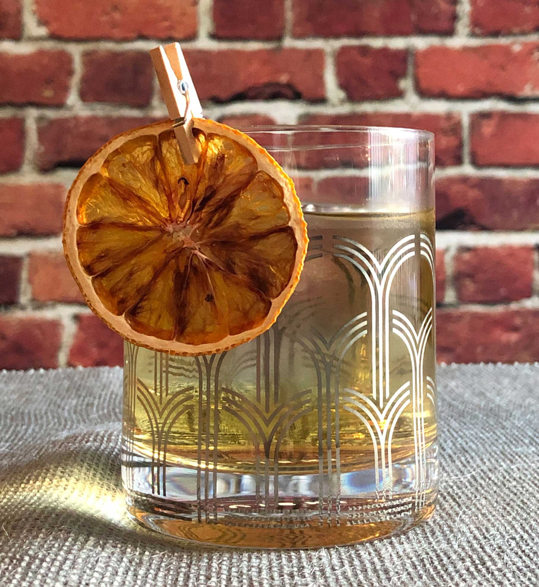 """An example of the Charlotte Gainsbourg, the mixed drink (cocktail), by Kelley Swenson, Portland, Oregon, from the book """"Left Coast Libations"""", featuring Cocchi Americano Bianco, orange-flavored liqueur, and pastis; photo by Lee Edwards"""