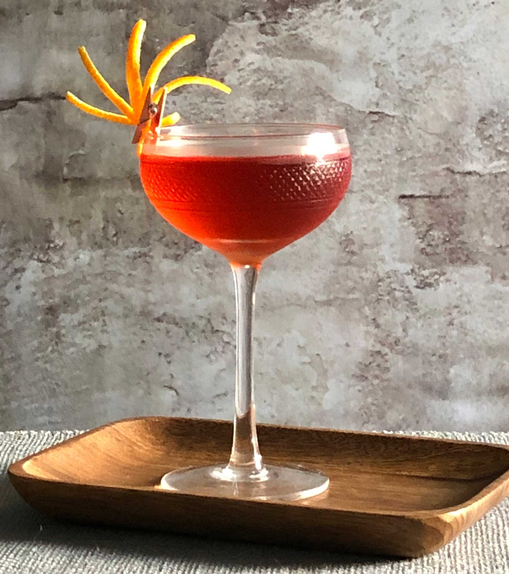 An example of the Negroni Rosa, the mixed drink (cocktail) featuring Hayman's London Dry Gin, Cocchi Americano Rosa, and Aperitivo Cappelletti; photo by Lee Edwards