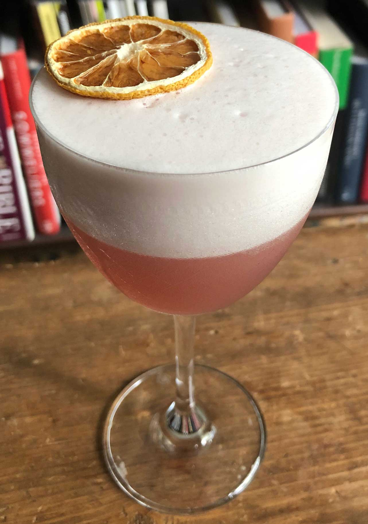 An example of the Rosa Sour, the mixed drink (sour) featuring Cocchi Americano Rosa, egg white, lemon juice, and simple syrup; photo by Lee Edwards