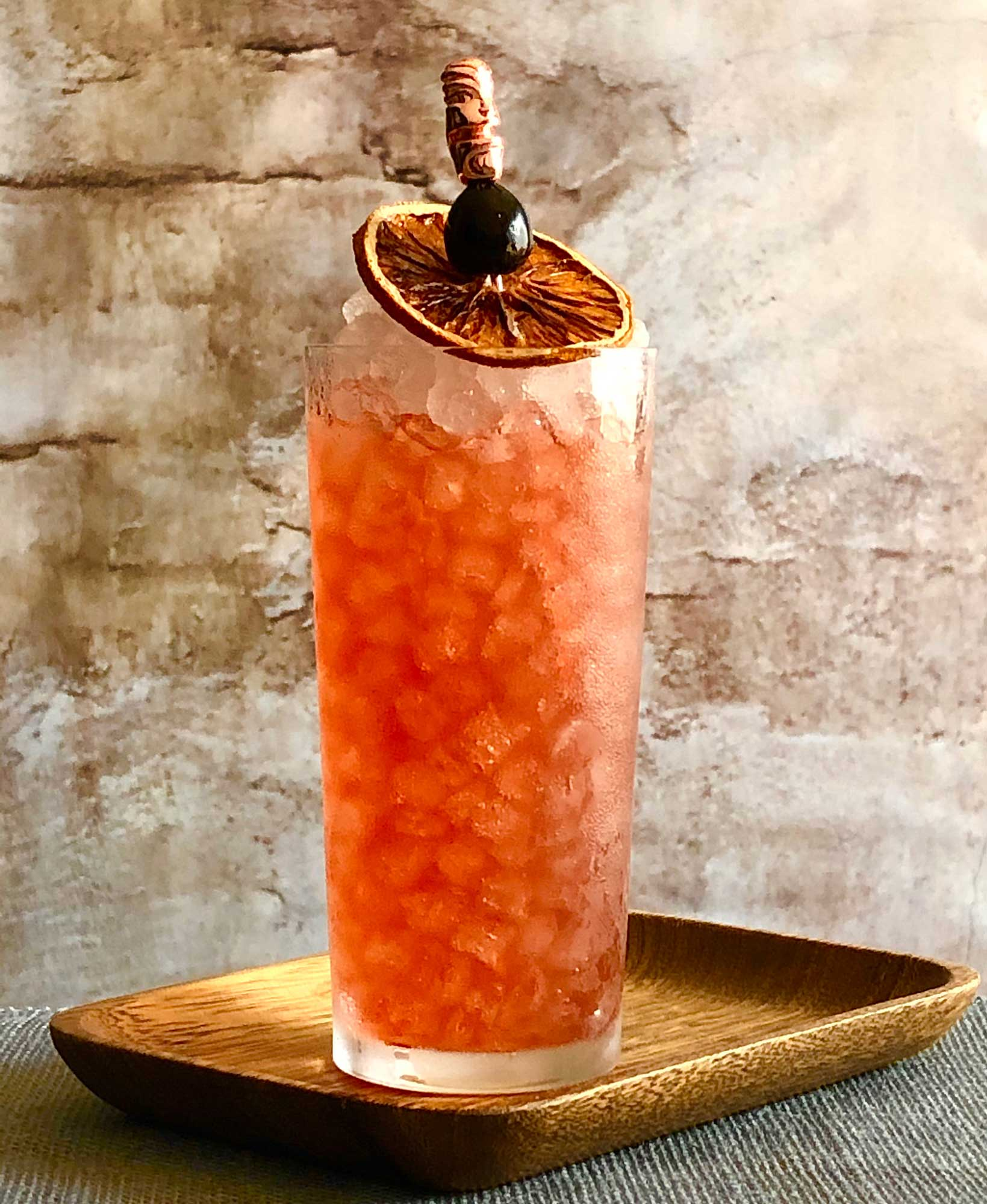 An example of the Seaside Frivolity, the mixed drink (cocktail), by Lee Edwards, featuring Cocchi Americano Rosa, Hayman's Old Tom Gin, orange juice, Rothman & Winter Orchard Peach Liqueur, and grenadine; photo by Lee Edwards