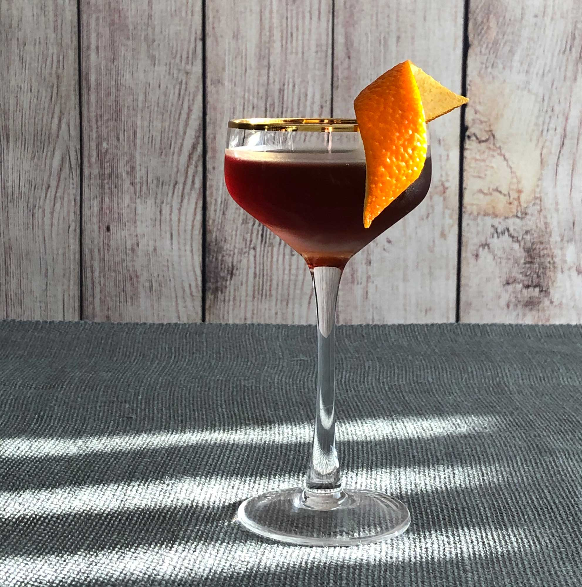 An example of the Hugo Black, the mixed drink (cocktail) featuring rye whiskey, and Cocchi Barolo Chinato; photo by Lee Edwards