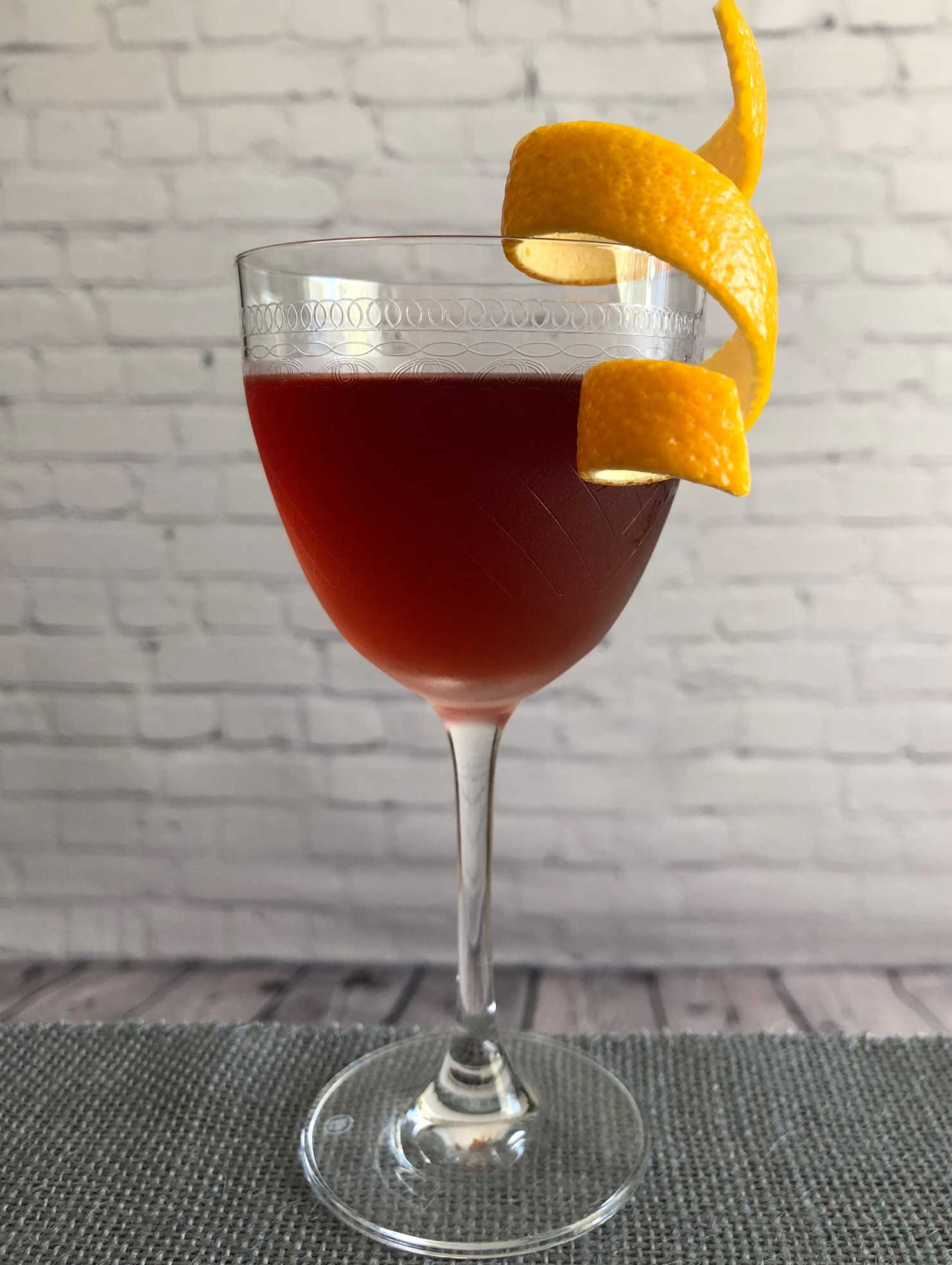 An example of the Fair Thee Well, the mixed drink (cocktail), by Brian Means, Fifth Floor, San Francisco, featuring bourbon whiskey, Cocchi Barolo Chinato, and Pierre Ferrand Ancient Formula Orange Curaçao; photo by Lee Edwards