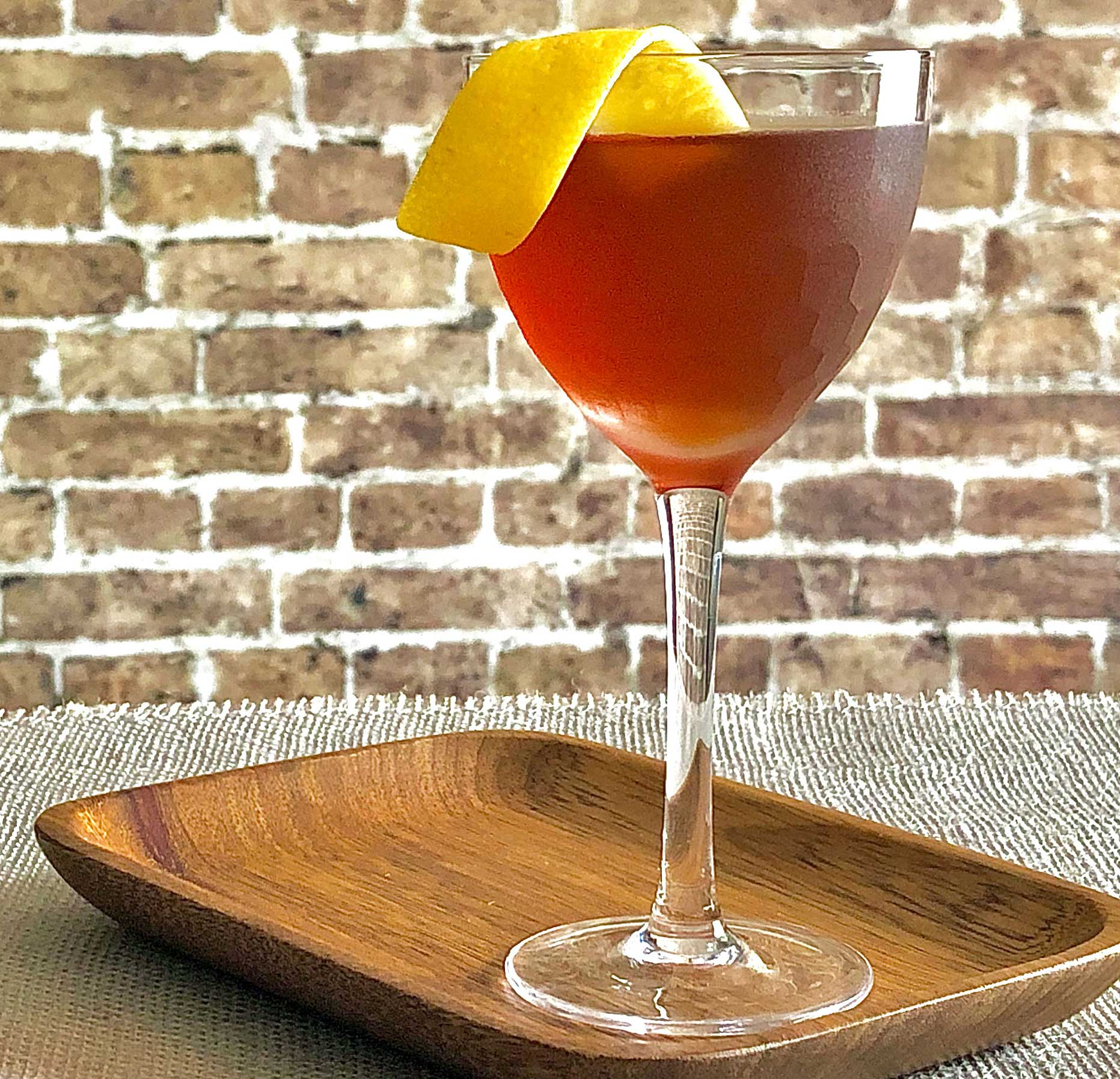 An example of the Fort Point, the mixed drink (cocktail), by Erik Adkins, Heaven's Dog, San Francisco, featuring rye whiskey, Cocchi Barolo Chinato, and Rothman & Winter Orchard Apricot Liqueur; photo by Lee Edwards