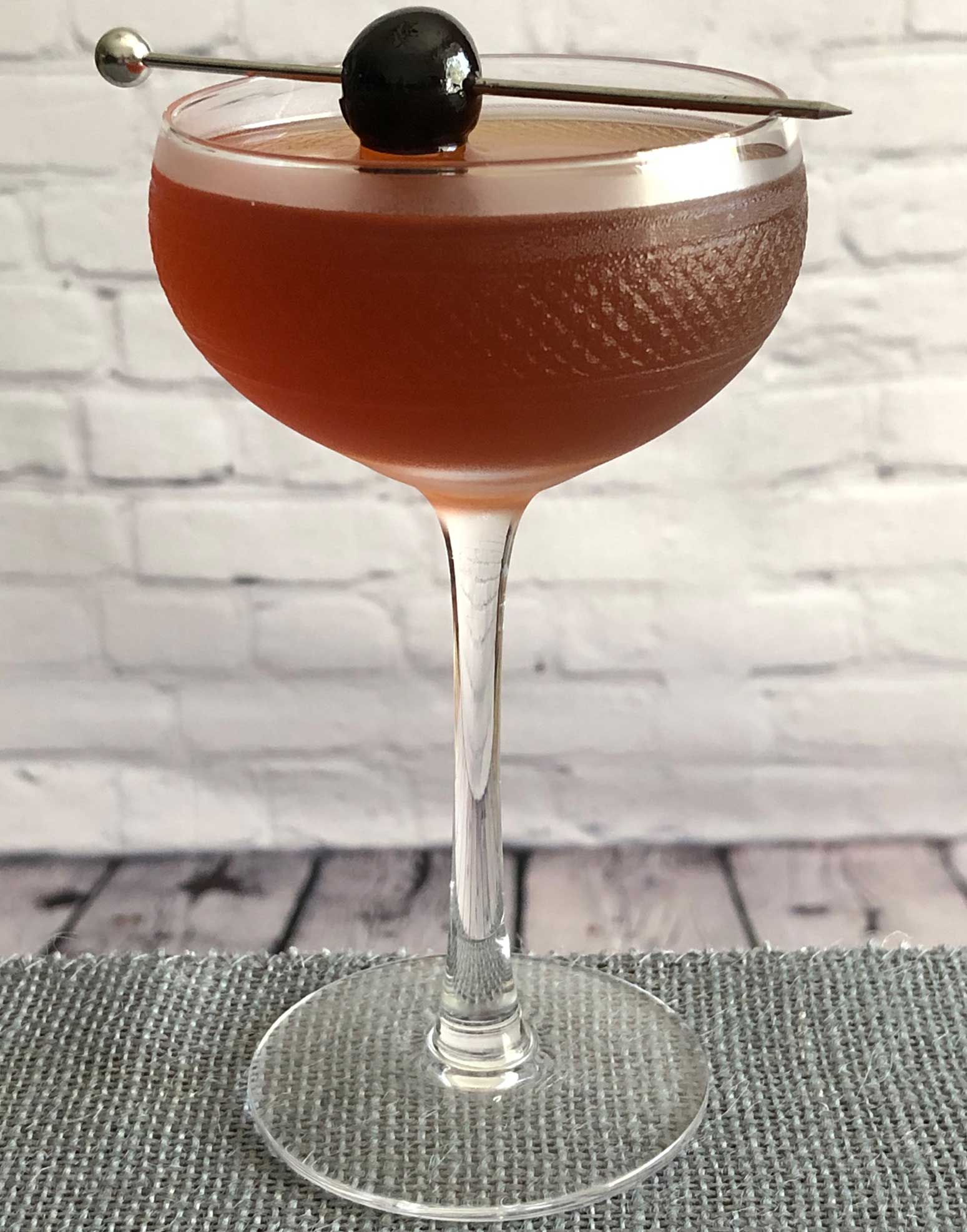 An example of the Remember the Maine, the mixed drink (cocktail) featuring rye whiskey, Cocchi Vermouth di Torino, Rothman & Winter Orchard Cherry Liqueur, and absinthe; photo by Lee Edwards