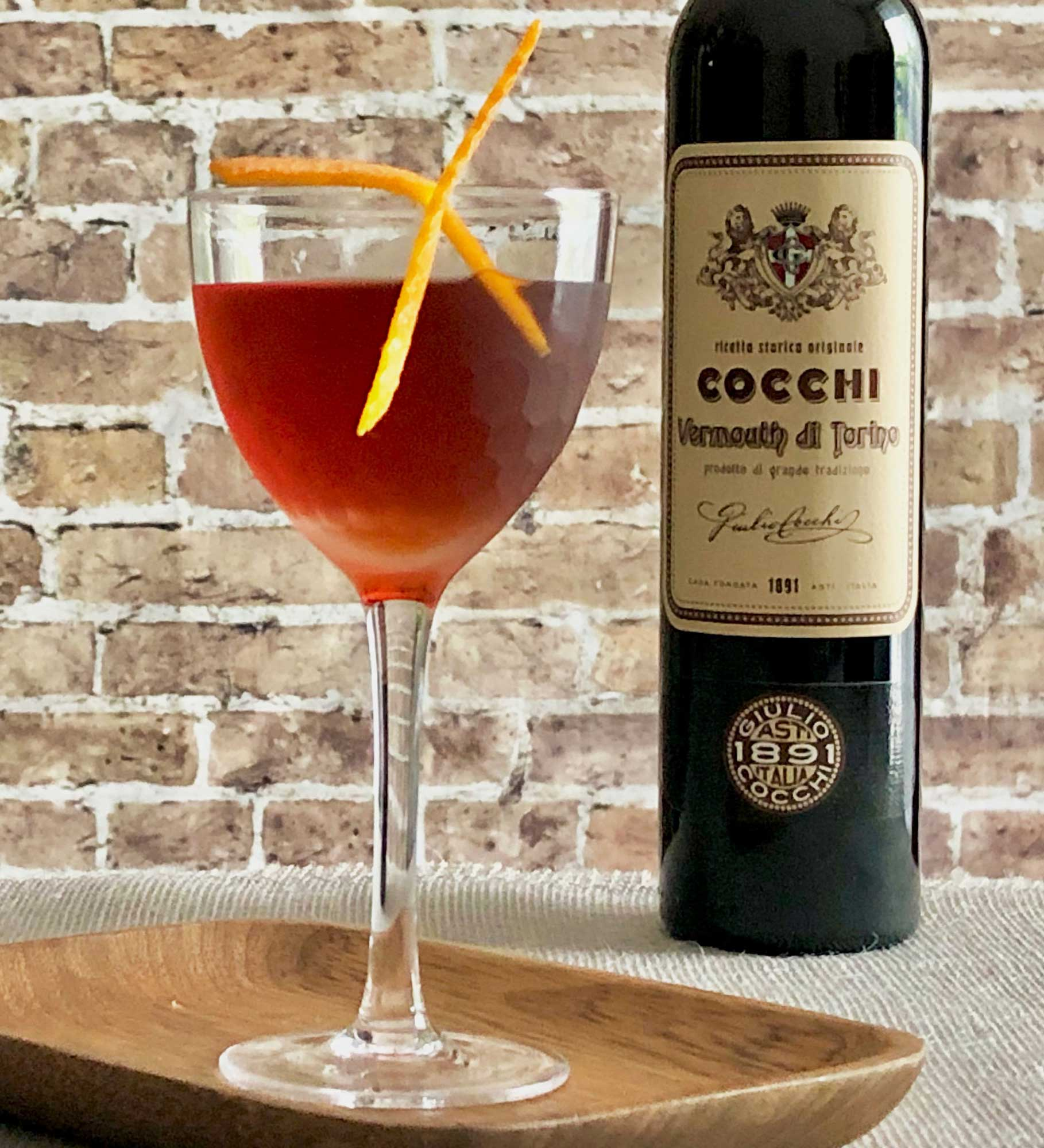 An example of the Golden Grove, the mixed drink (cocktail) featuring Cocchi Vermouth di Torino, Smith & Cross Traditional Jamaica Rum, maraschino liqueur, and orange bitters; photo by Lee Edwards