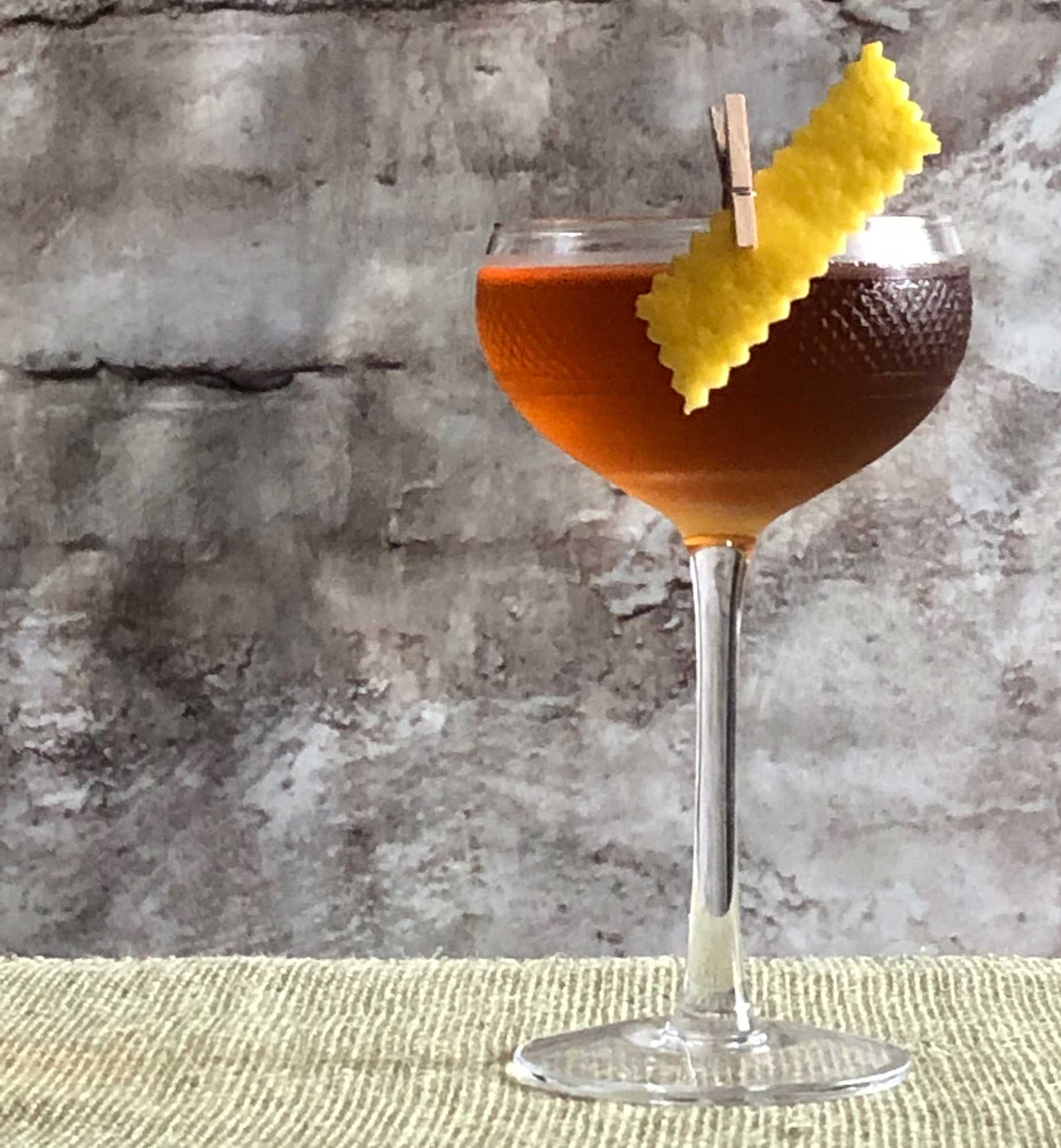 An example of the Jewel Cocktail, the mixed drink (cocktail) featuring Dolin Génépy le Chamois Liqueur, Hayman's London Dry Gin, Cocchi Vermouth di Torino, and orange bitters; photo by Lee Edwards