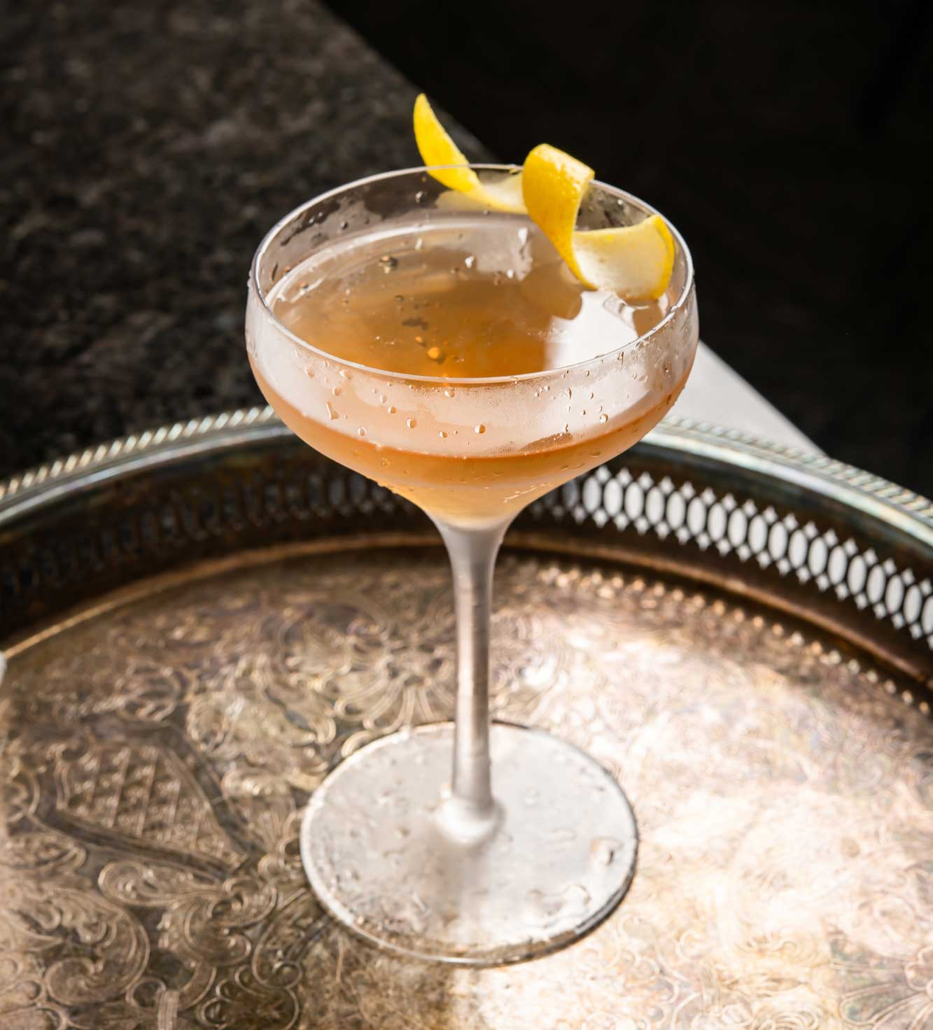 An example of the El Presidente, the mixed drink (cocktail) featuring light rum, Comoz Vermouth Blanc or Dolin Blanc Vermouth de Chambéry, curaçao, and grenadine; photo by Jose Pereiro