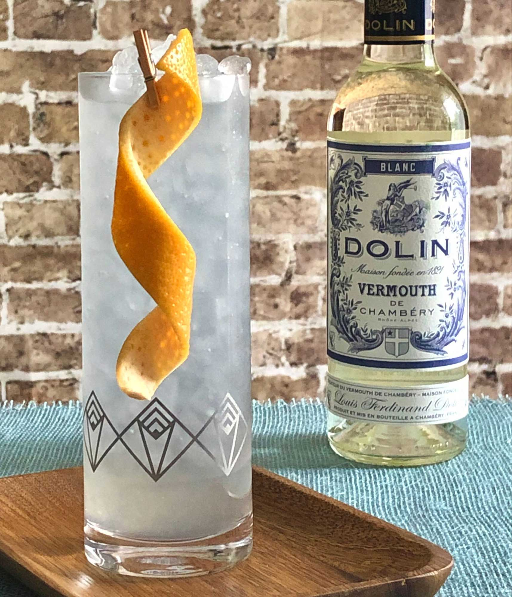 An example of the Canne Collins, the mixed drink (collins) featuring soda water, rhum agricole blanc, Dolin Blanc Vermouth de Chambéry, lemon juice, simple syrup, and Rothman & Winter Crème de Violette; photo by Lee Edwards