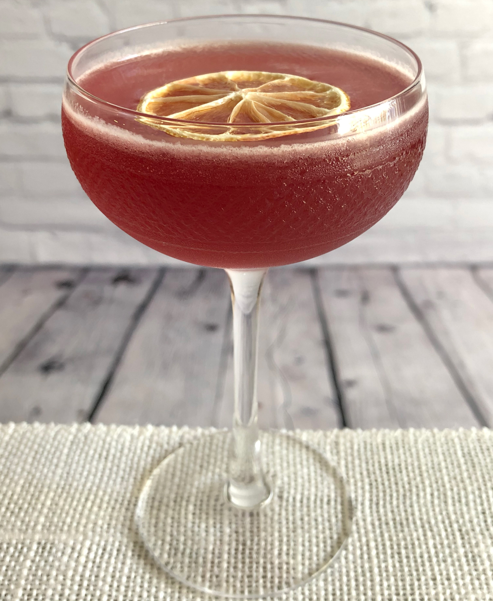 An example of the Scofflaw, the mixed drink (cocktail) featuring rye whiskey, Dolin Dry Vermouth de Chambéry, lemon juice, and grenadine; photo by Lee Edwards