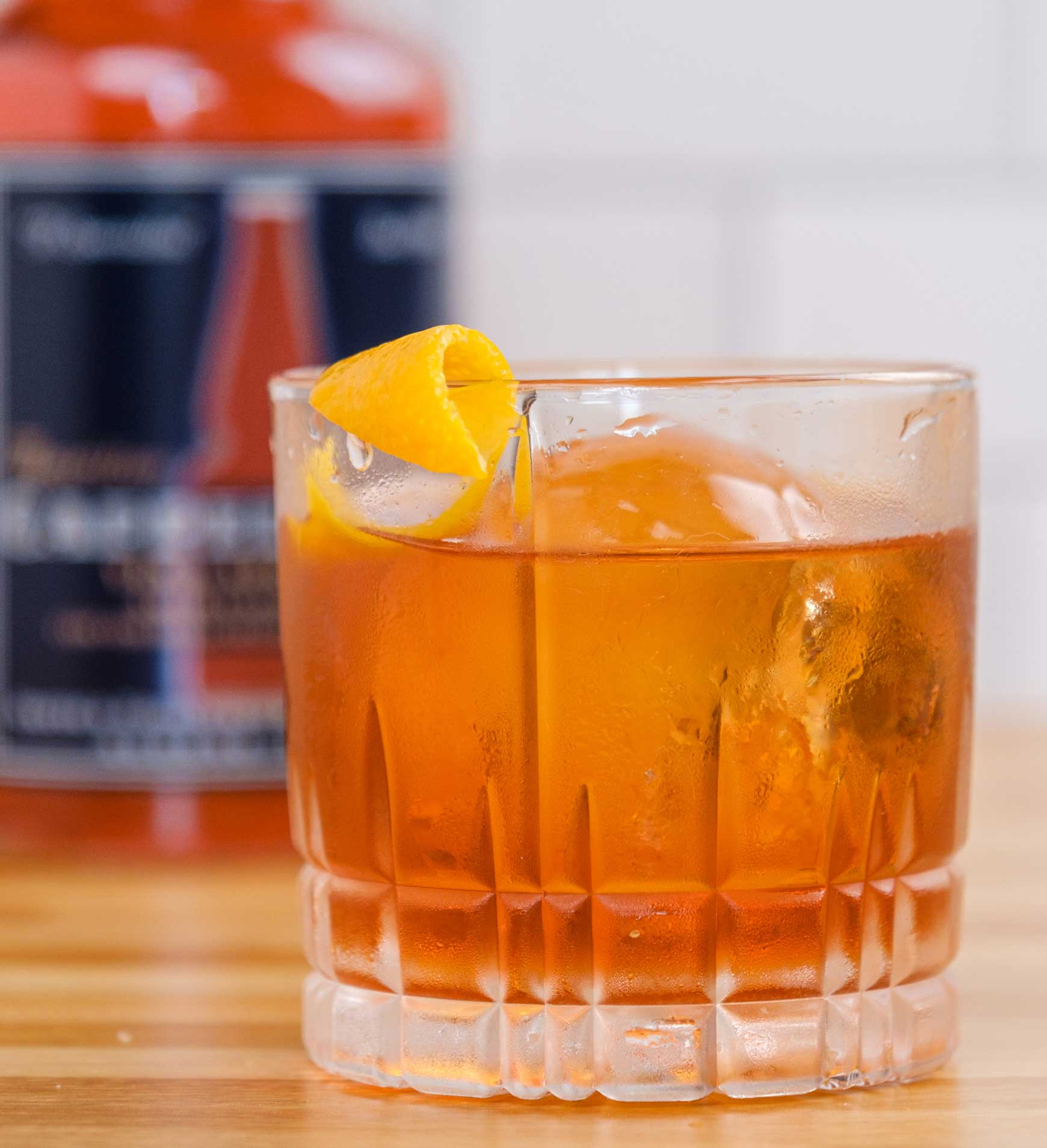 An example of the Boulevardier, the mixed drink (cocktail) featuring bourbon whiskey or rye whiskey, Aperitivo Cappelletti, and Dolin Rouge Vermouth de Chambéry; photo by Miranda Hodge