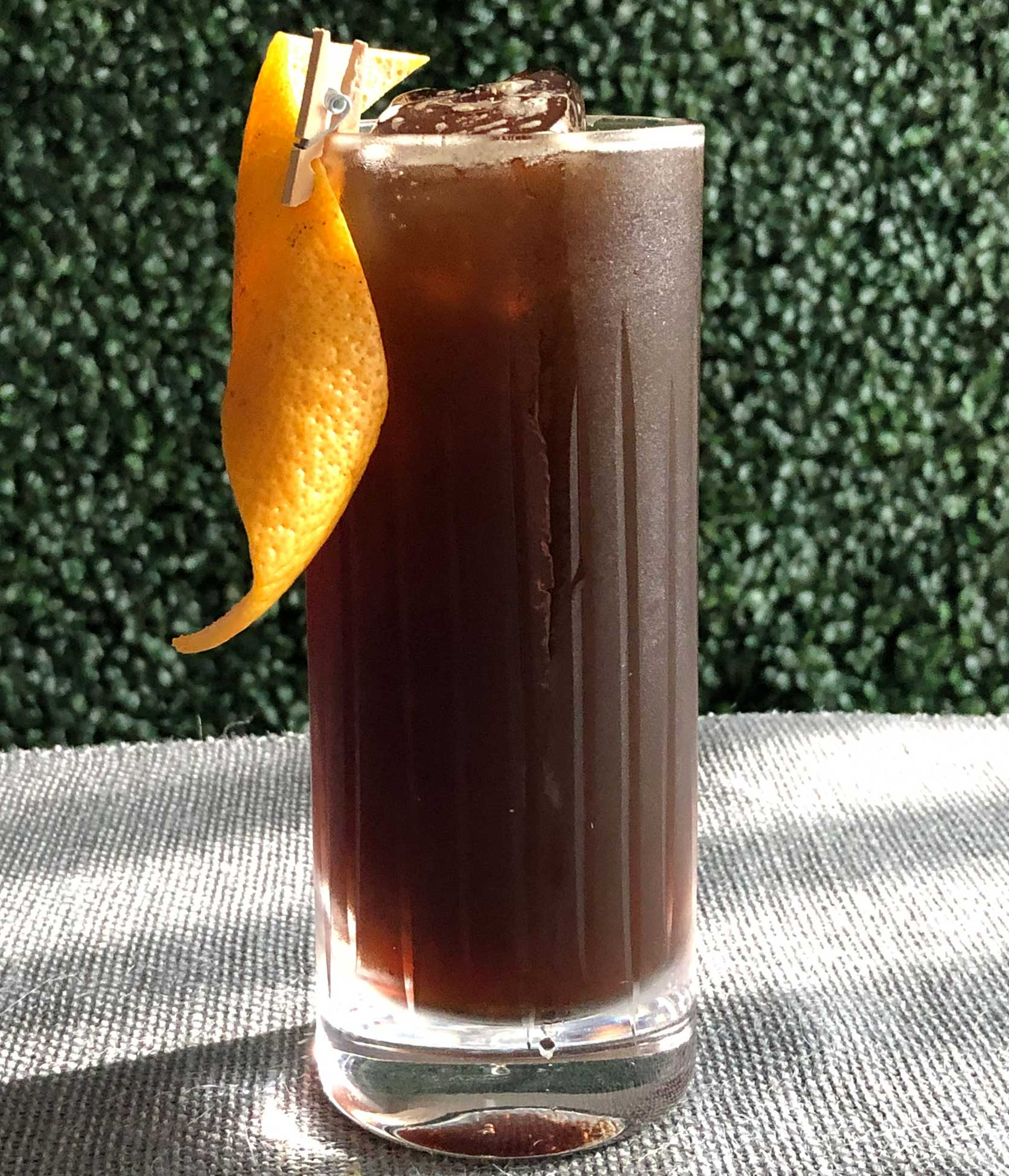 An example of the Poker Face, the mixed drink (cocktail) featuring Fentimans Curiosity Cola, Elisir Novasalus, Salers Gentian Apéritif, and Zirbenz Stone Pine Liqueur of the Alps; photo by Lee Edwards