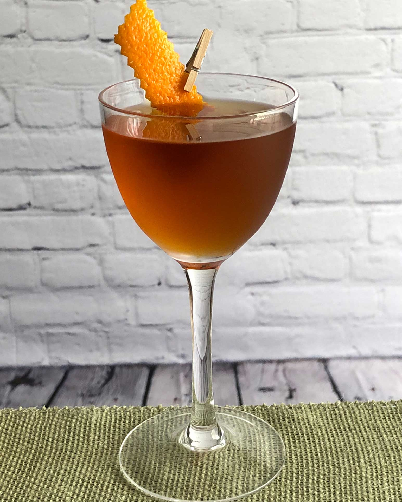 An example of the Hackensack, the mixed drink (cocktail), by based on the Newark, PDT, New York City, featuring apple brandy, Cocchi Vermouth di Torino, maraschino liqueur, and Elisir Novasalus; photo by Lee Edwards