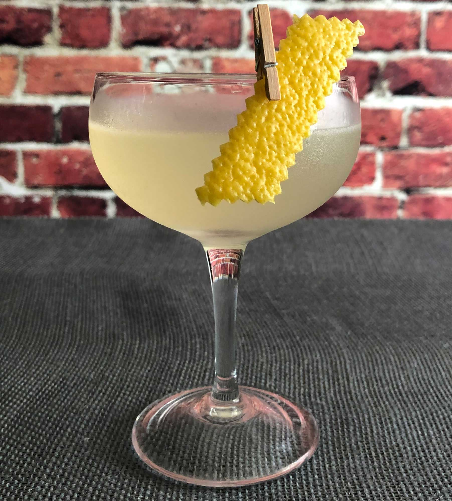 An example of the Aquitania, the mixed drink (cocktail), by David Embury, The Fine Art of Mixing Drinks, featuring Hayman's London Dry Gin, Rothman & Winter Orchard Apricot Liqueur, lime juice, and simple syrup; photo by Lee Edwards