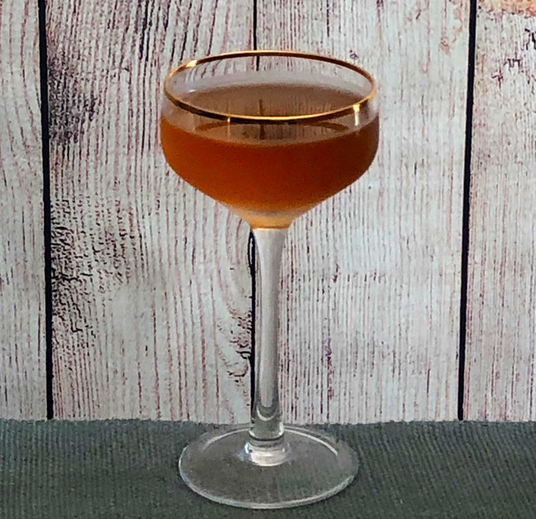 """An example of the Club Cocktail, the mixed drink (cocktail), by The Only William, """"Flowing Bowl"""", featuring Hayman's Old Tom Gin, Dolin Rouge Vermouth de Chambéry, simple syrup or gum syrup, Dolin Génépy le Chamois Liqueur, and orange bitters; photo by Lee Edwards"""