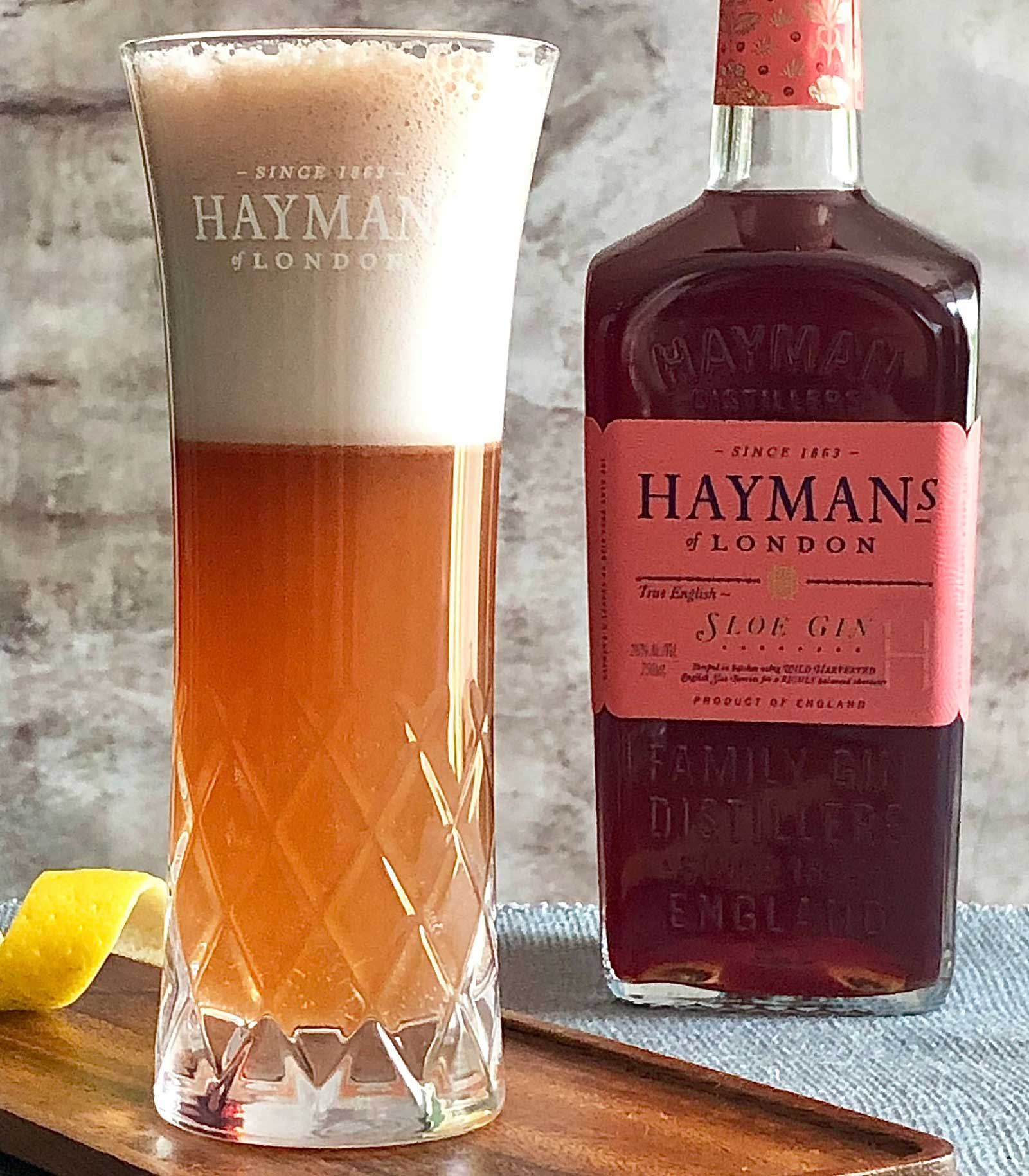 An example of the Sloe Gin Fizz, the mixed drink (fizz) featuring soda water, egg white, Hayman's Sloe Gin, Hayman's London Dry Gin, lemon juice, and simple syrup; photo by Lee Edwards