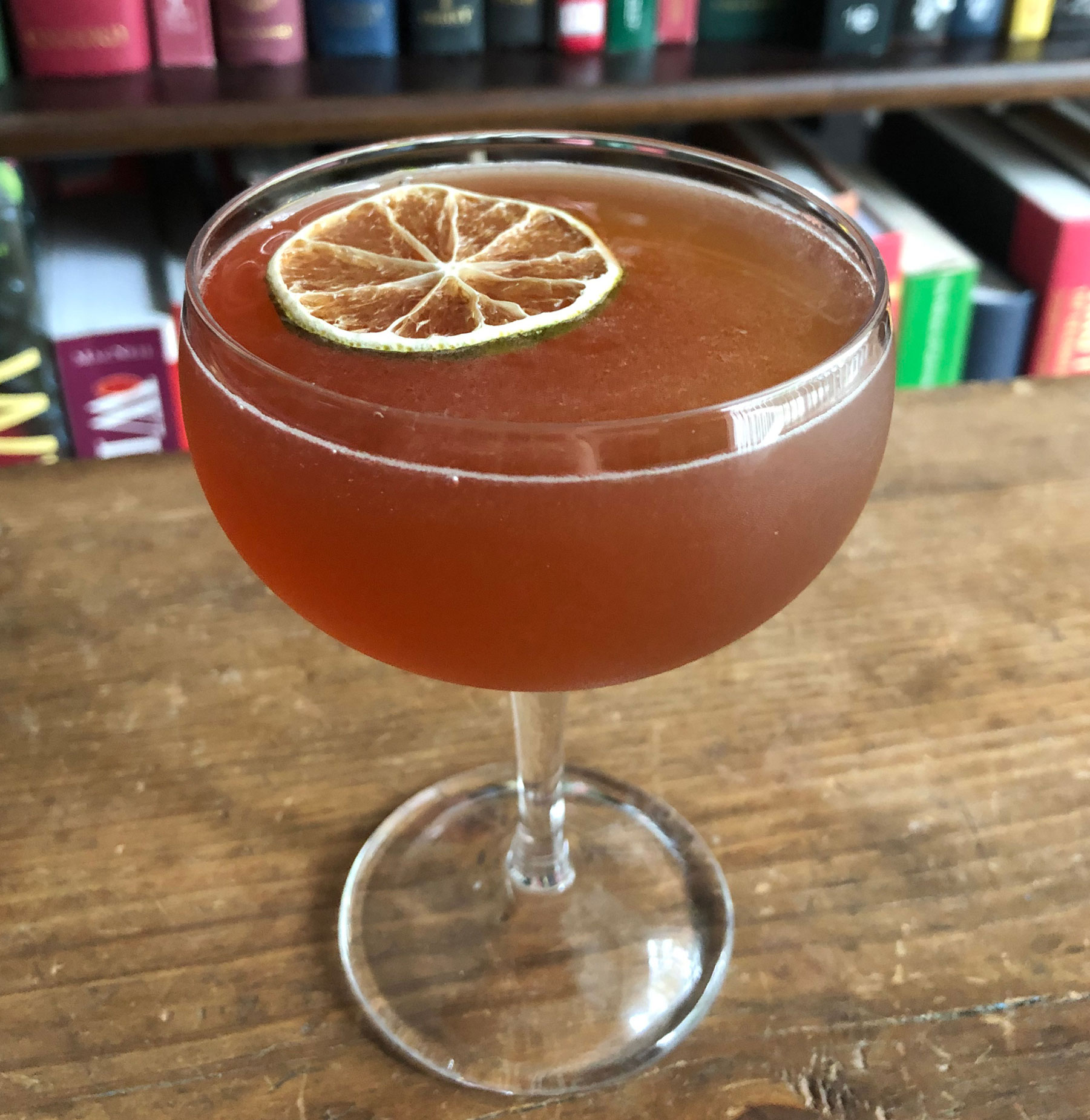 An example of the Millionaire No. 1, the mixed drink (cocktail), by Savoy Cocktail Book, featuring Hayman's Sloe Gin, Smith & Cross Traditional Jamaica Rum, Blume Marillen Apricot Eau-de-Vie, lime juice, grenadine, and simple syrup; photo by Lee Edwards