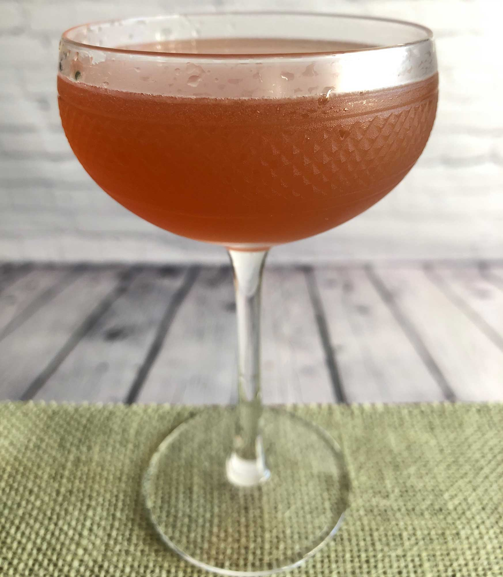 An example of the Post Modern, the mixed drink (cocktail), by Tom Richter, Dear Irving, New York City, featuring scotch whisky, Hayman's Sloe Gin, lemon juice, honey syrup, and absinthe; photo by Lee Edwards