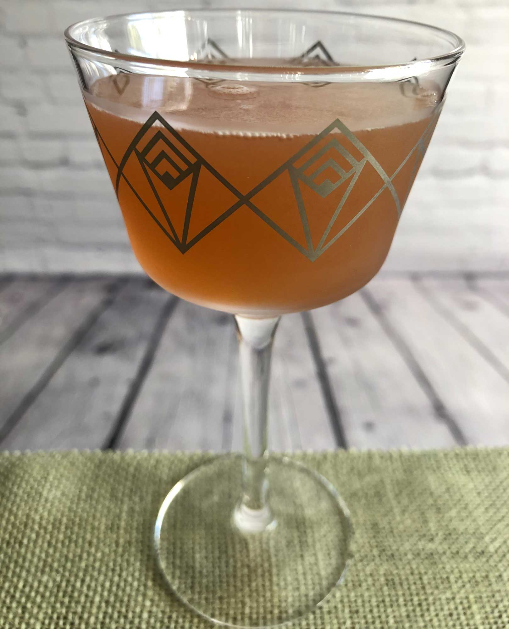 An example of the Demeter, the mixed drink (cocktail), adapted from the Persephone, PDT Cocktail Book, featuring applejack, Dolin Rouge Vermouth de Chambéry, Hayman's Sloe Gin, lemon juice, and simple syrup; photo by Lee Edwards