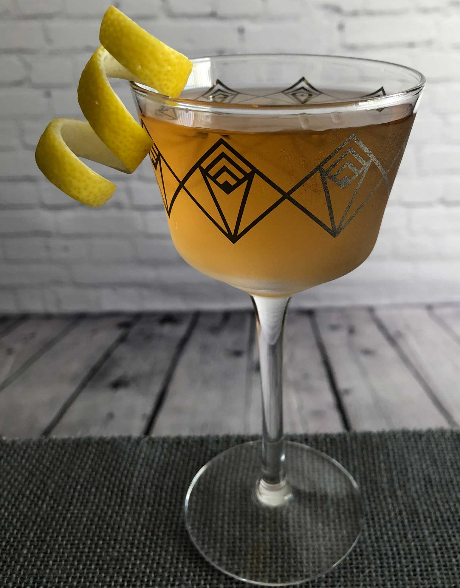 An example of the Prince Henry's Reed, the mixed drink (cocktail) featuring Henriques & Henriques Rainwater Madeira, Dolin Dry Vermouth de Chambéry, and orange bitters; photo by Lee Edwards