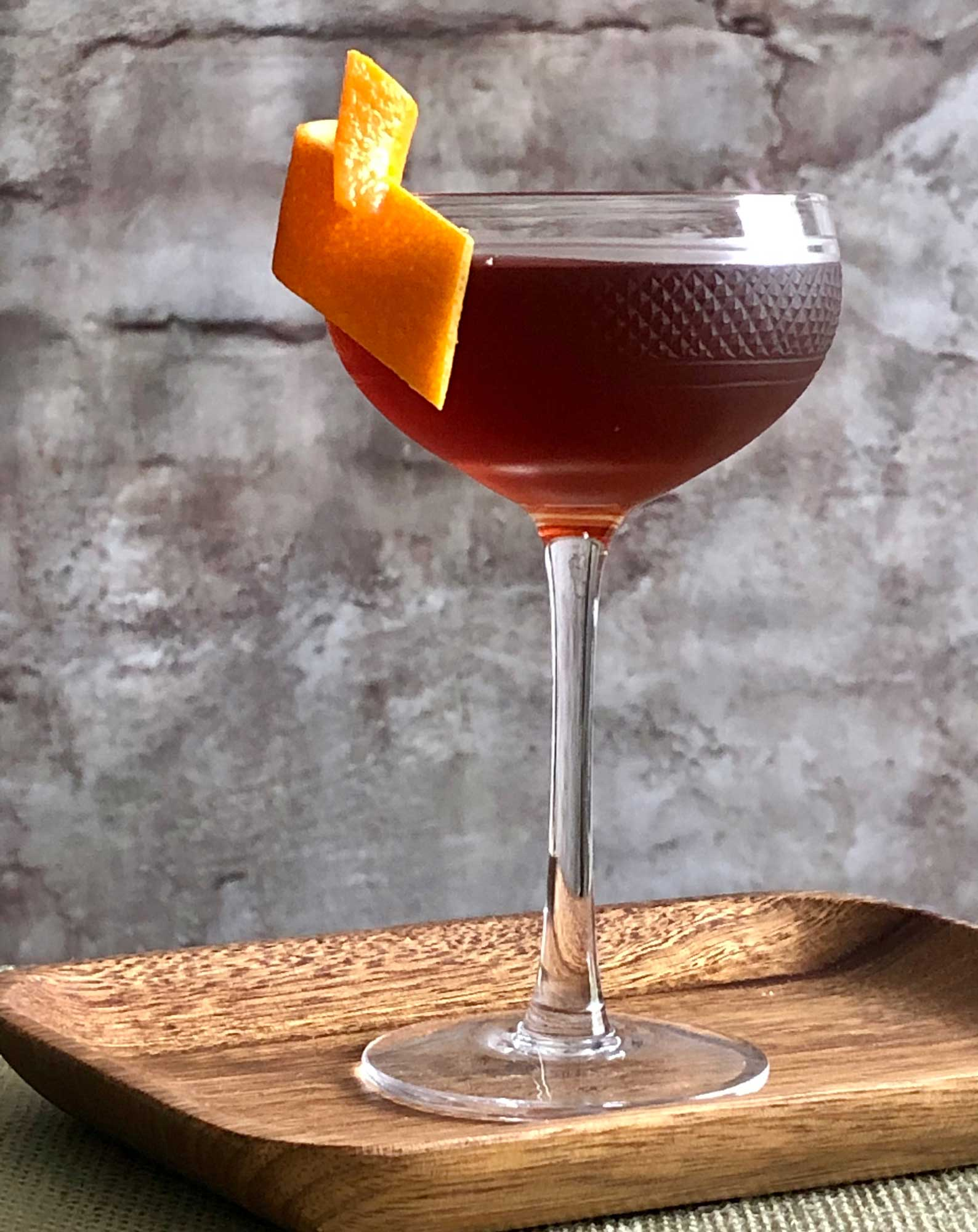An example of the Stadium of Light, the mixed drink (cocktail) featuring Henriques & Henriques Rainwater Madeira, Dolin Rouge Vermouth de Chambéry, orange bitters, and Angostura bitters; photo by Lee Edwards