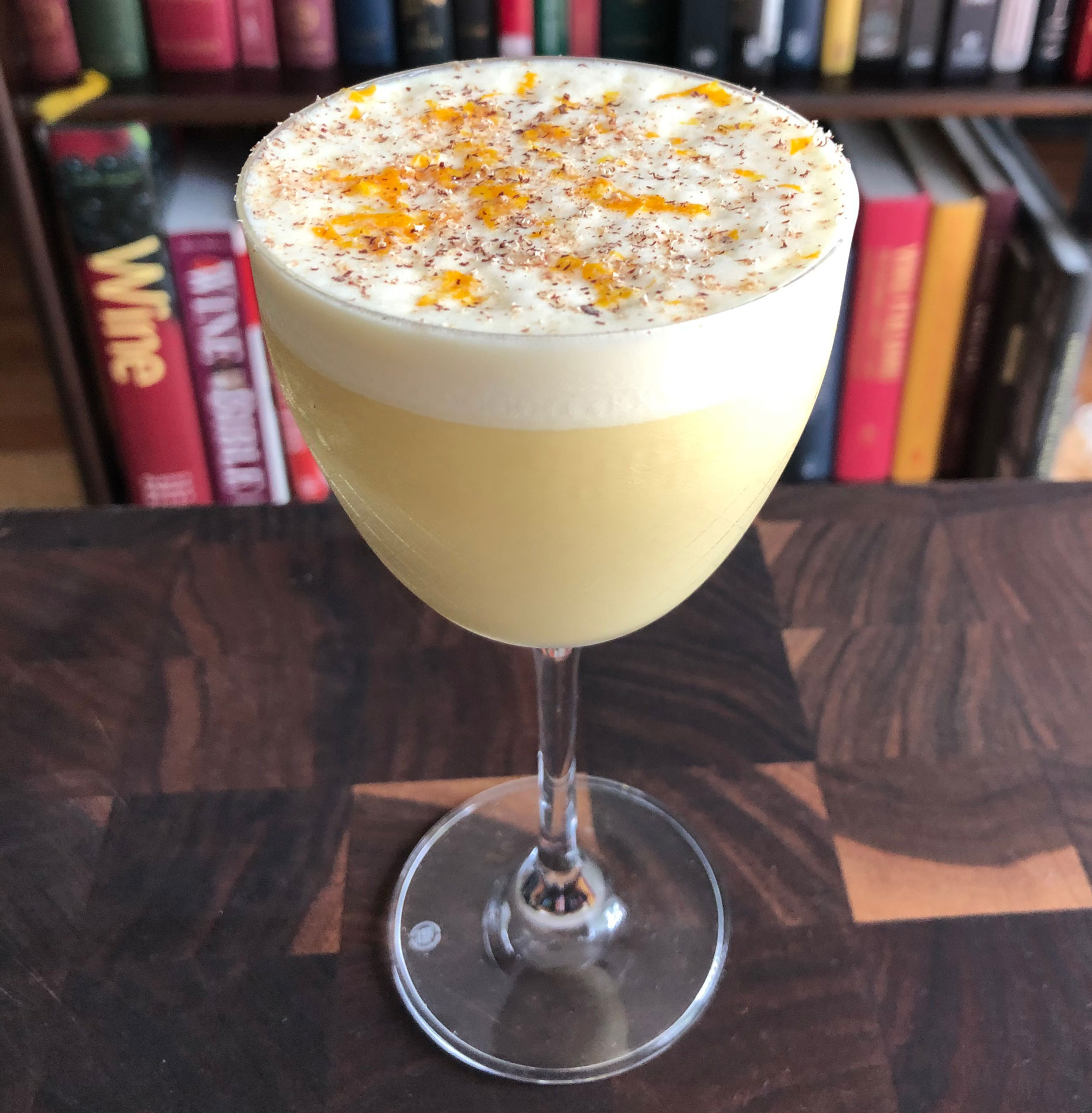 An example of the Frothy Stars, the mixed drink (cocktail), by Scott Beskow, Grunauer, Kansas City, MO, featuring raw egg, Henriques & Henriques Rainwater Madeira, half & half, and maple syrup; photo by Lee Edwards