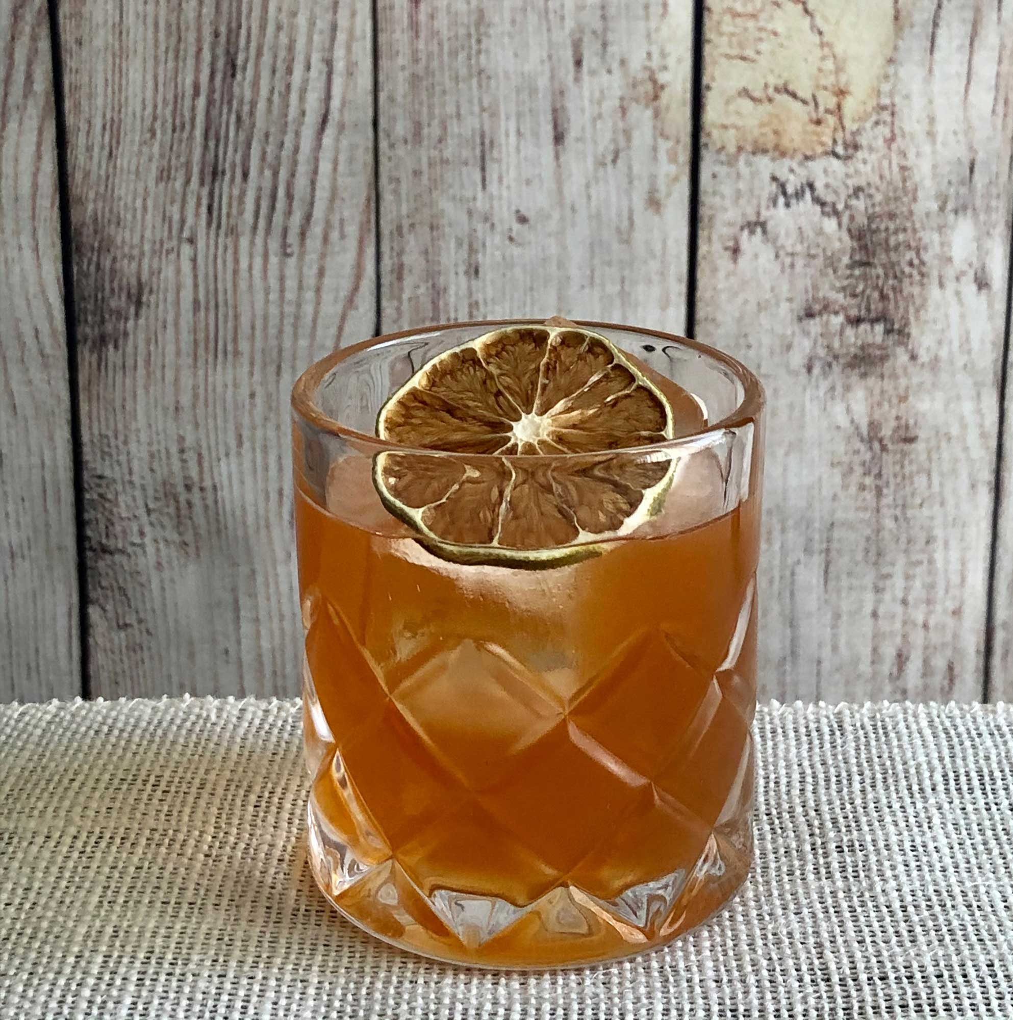 An example of the Bajan Legend, the mixed drink (cocktail) featuring brown barbados rum, John D. Taylor's Velvet Falernum, and Angostura bitters; photo by Lee Edwards