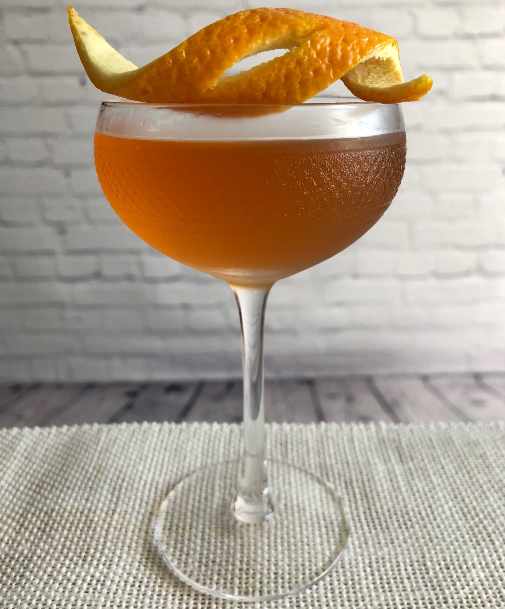 An example of the Boomerang Cocktail, the mixed drink (cocktail), by Savoy Cocktail Book, featuring Kronan Swedish Punsch, rye whiskey, Dolin Dry Vermouth de Chambéry, lemon juice, Angostura bitters, and orange bitters; photo by Lee Edwards