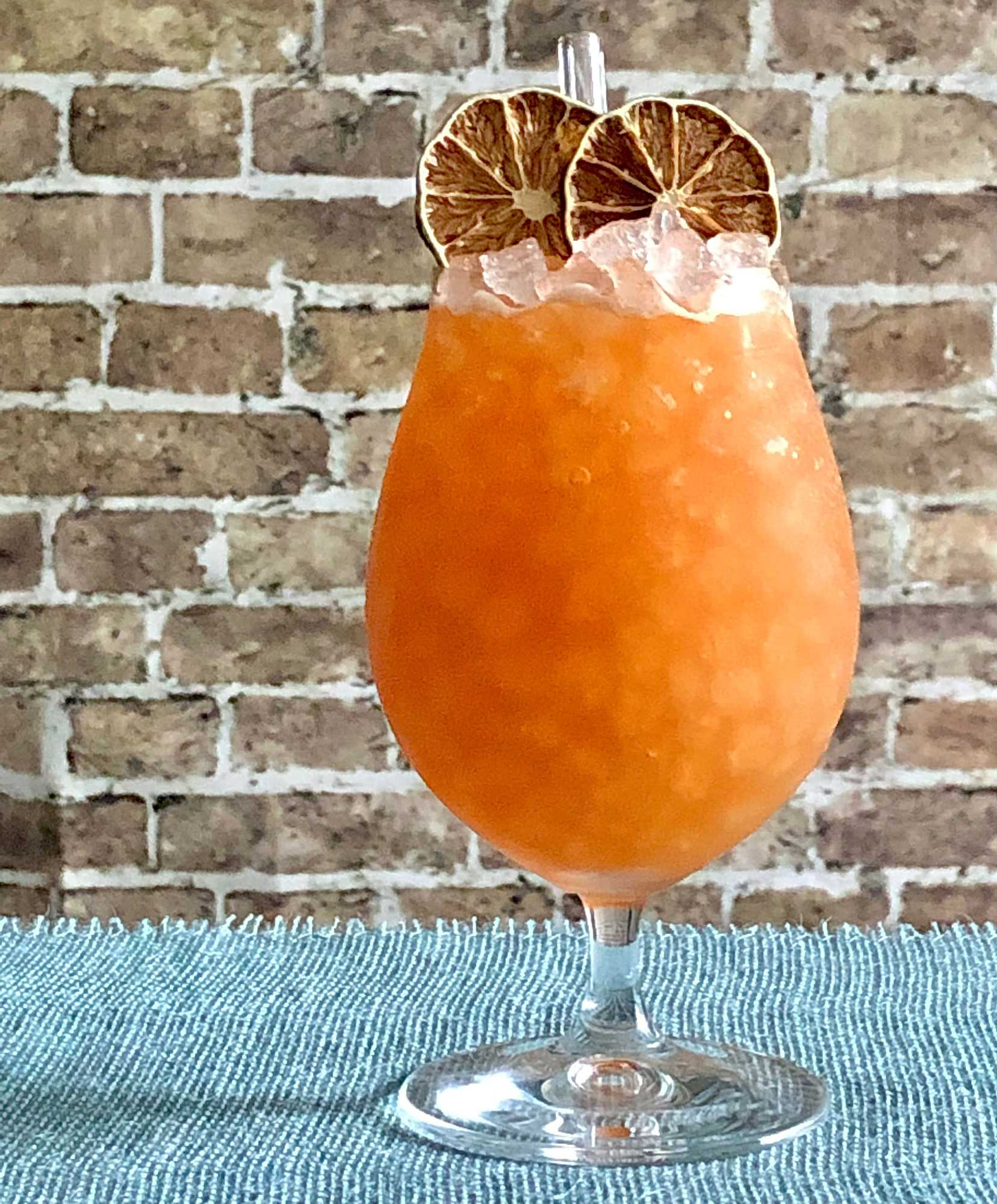 An example of the Anna Skytte's Raid, the mixed drink (cocktail), by Luiggi Uzcategui, Big Orange, Little Rock, AR, featuring Kronan Swedish Punsch, rye whiskey, lime juice, Smith & Cross Traditional Jamaica Rum, Carlsbad Becherovka Bitter, Angostura bitters, and St. Elizabeth Allspice Dram; photo by Lee Edwards