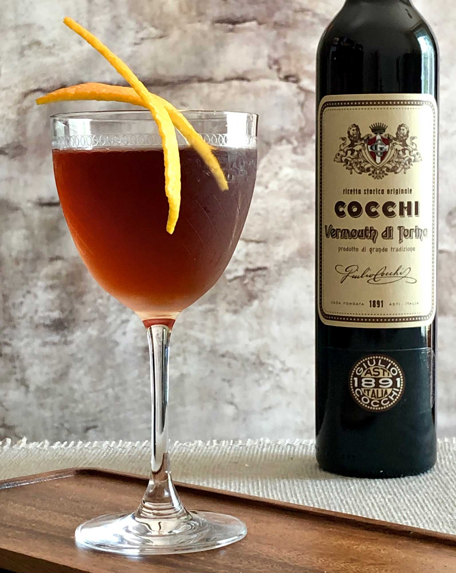 An example of the Martinez de Colón, the mixed drink (cocktail) featuring mezcal, Cocchi Vermouth di Torino, maraschino liqueur, Angostura bitters, and orange bitters; photo by Lee Edwards
