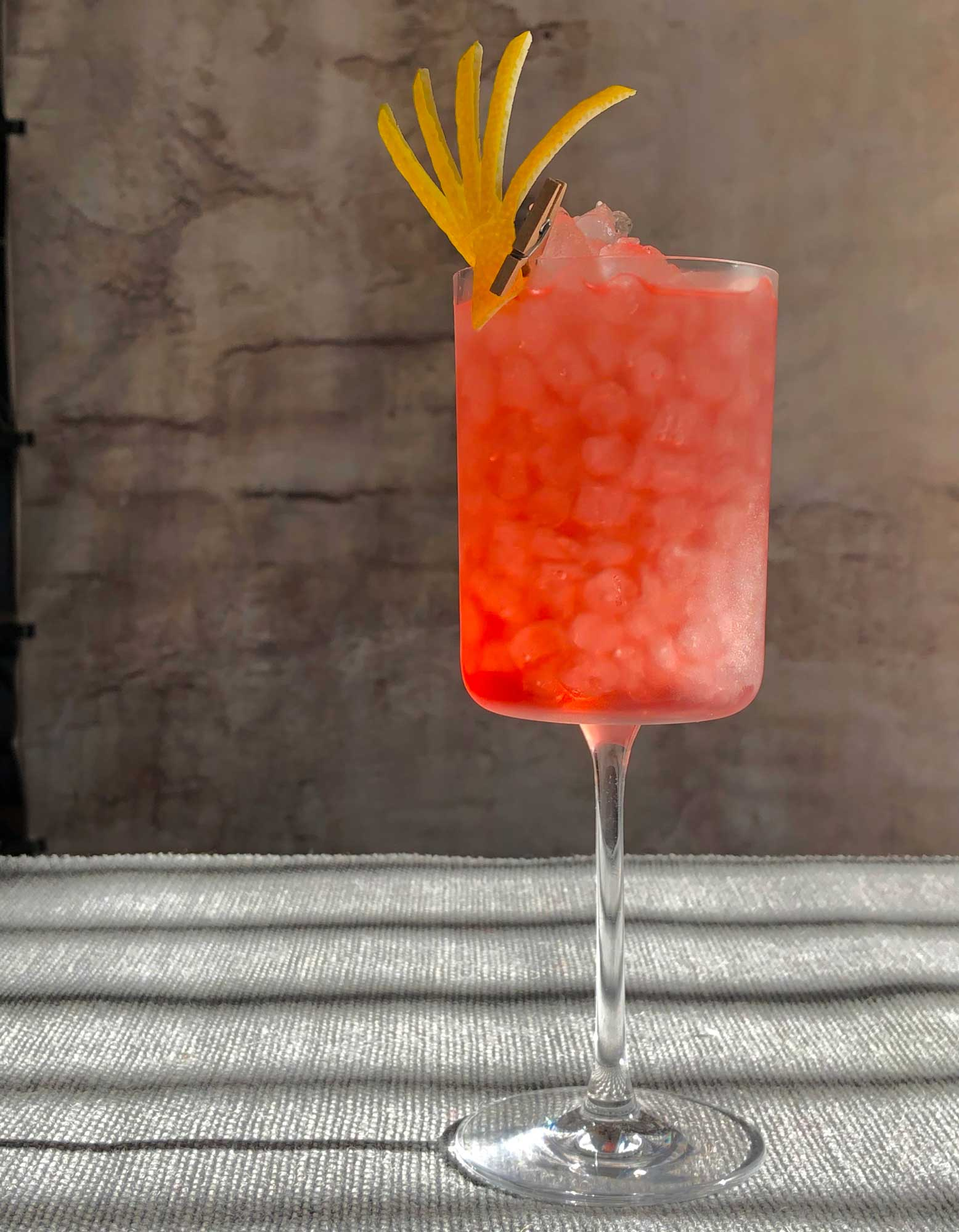 An example of the Santa Rosa Highball, the mixed drink (highball) featuring grapefruit soda, Cocchi Americano Rosa, and blanco tequila; photo by Lee Edwards